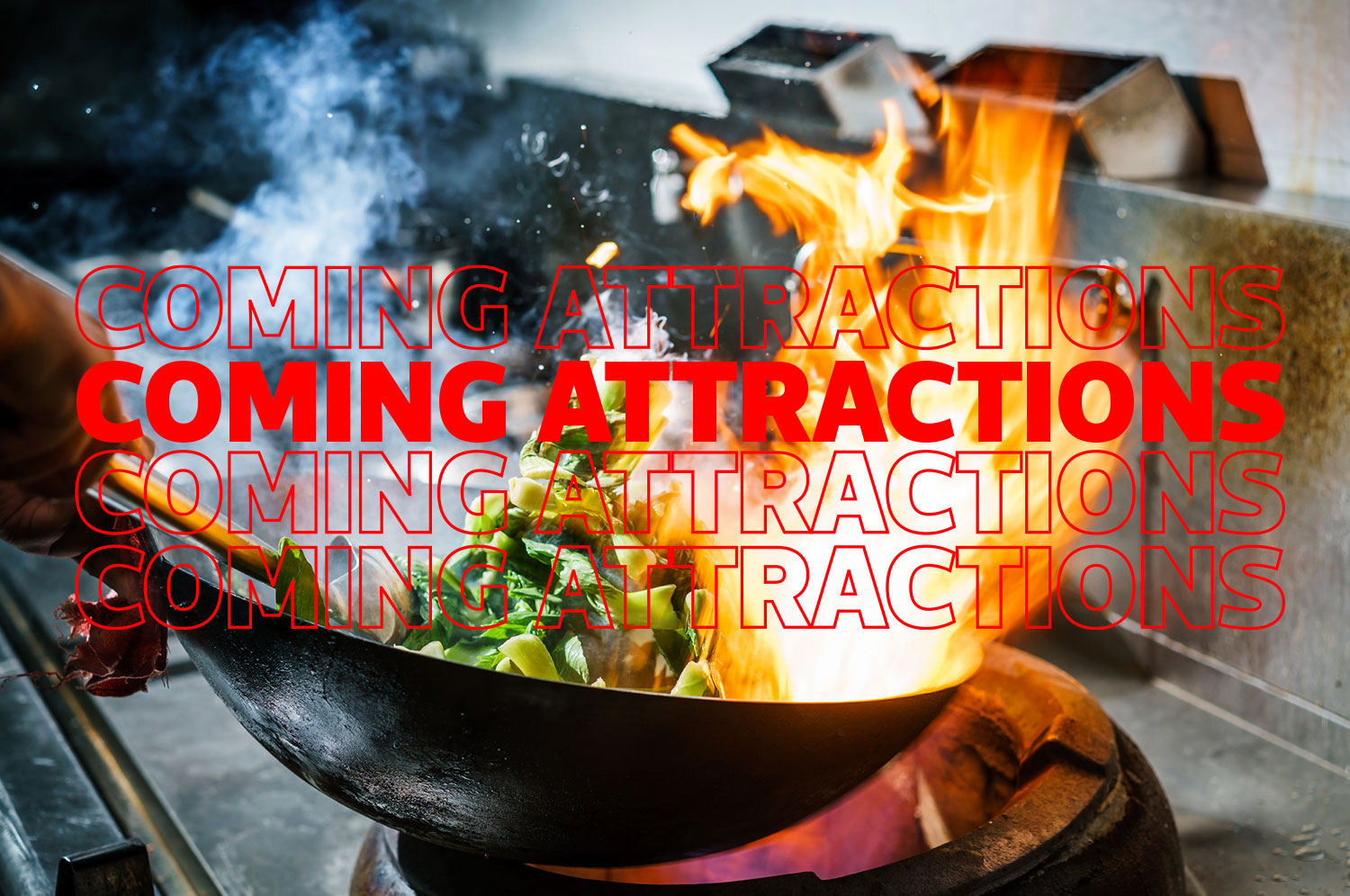 A wok being cooked with green leafy vegetables and a burst of fire over a stove