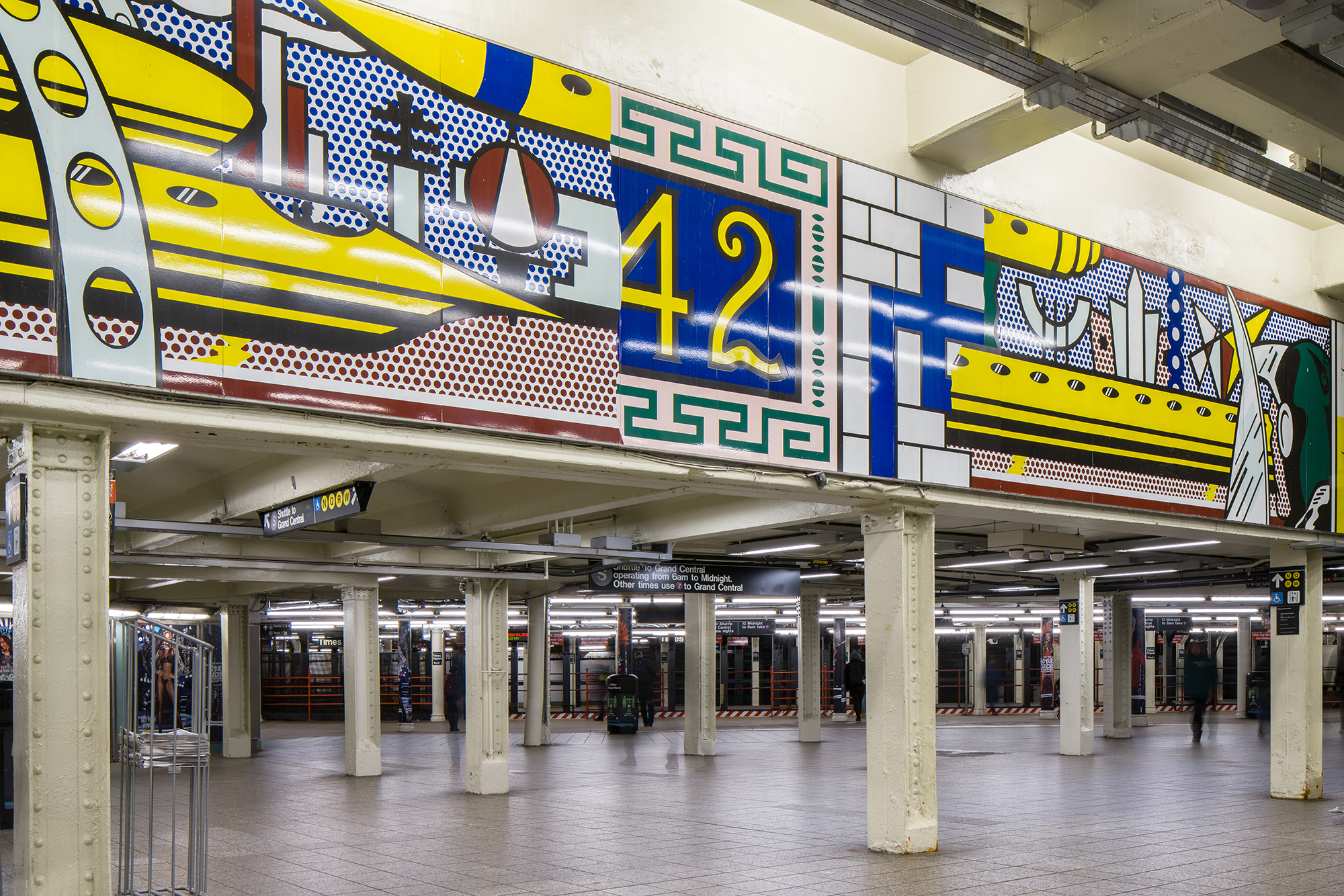 A colorful mural installed in a subway station.
