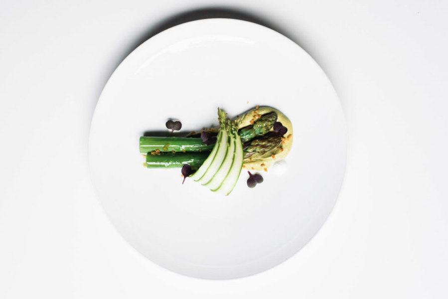 An asparagus dish on a white plate