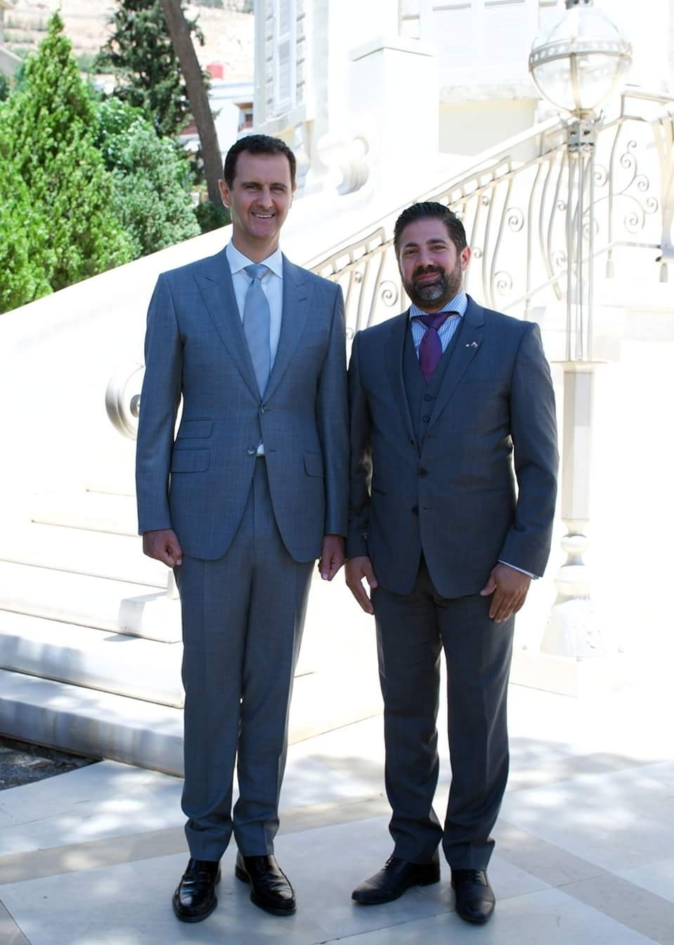 Waseem Ramli (right) poses with Syrian president Bassar al-Assad.