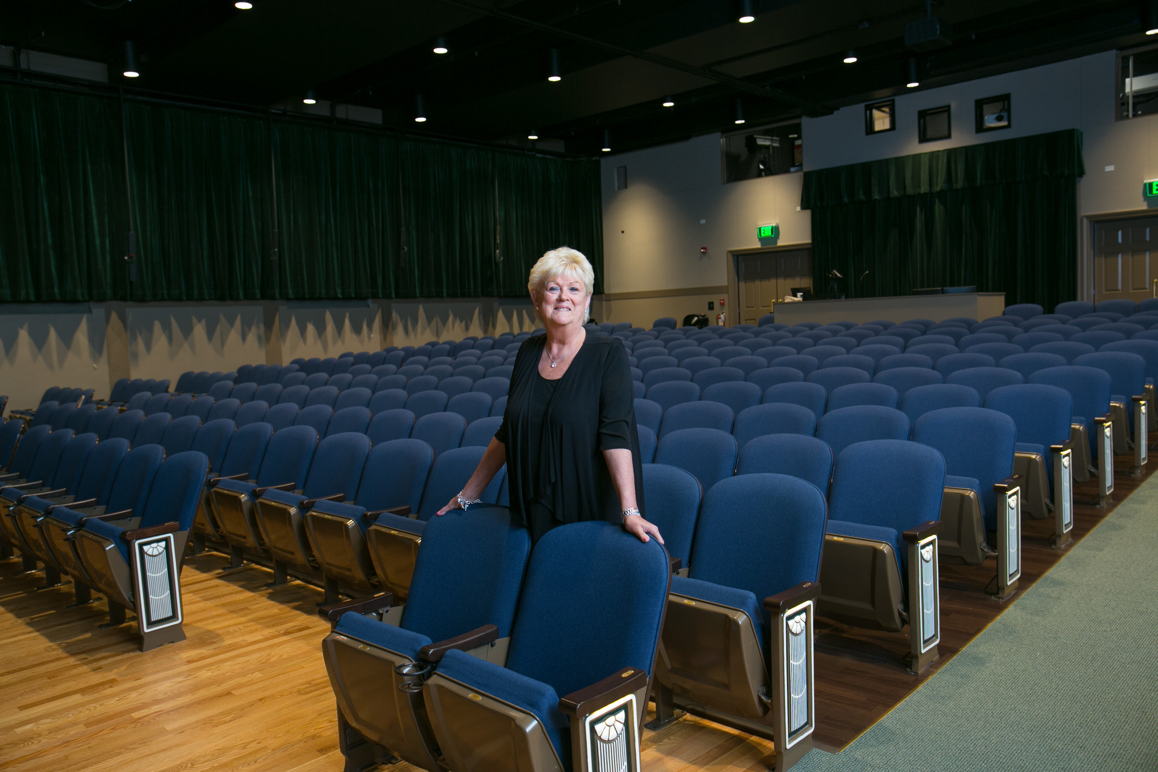 Nancy Hughes at one of the many beneficiaries of her philanthropy: the John & Nancy Hughes Theater at Gorton Community Center in Lake Forest.
