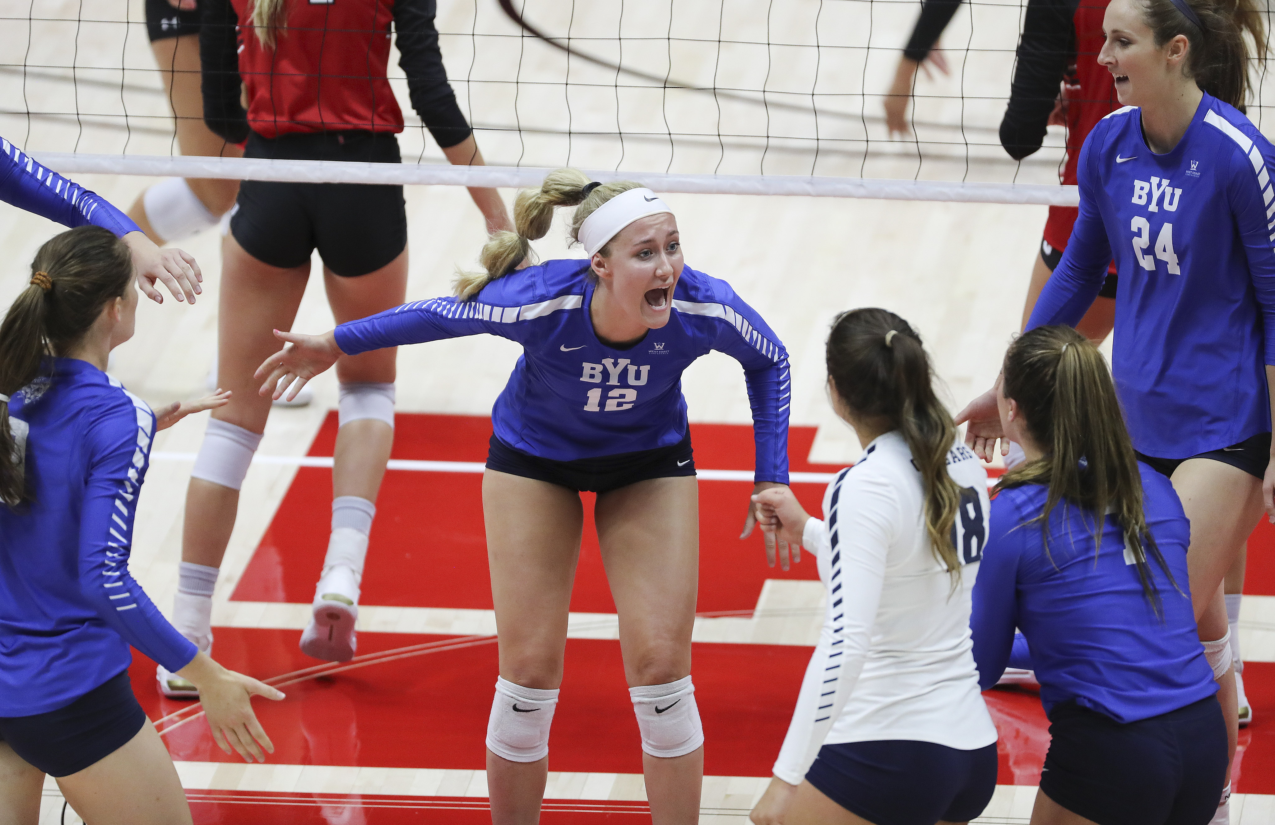 Brigham Young University's Kate Grimmer (12) shouts after a point against the University of Utah in volleyball in Salt Lake City on Thursday, Sept. 19, 2019.