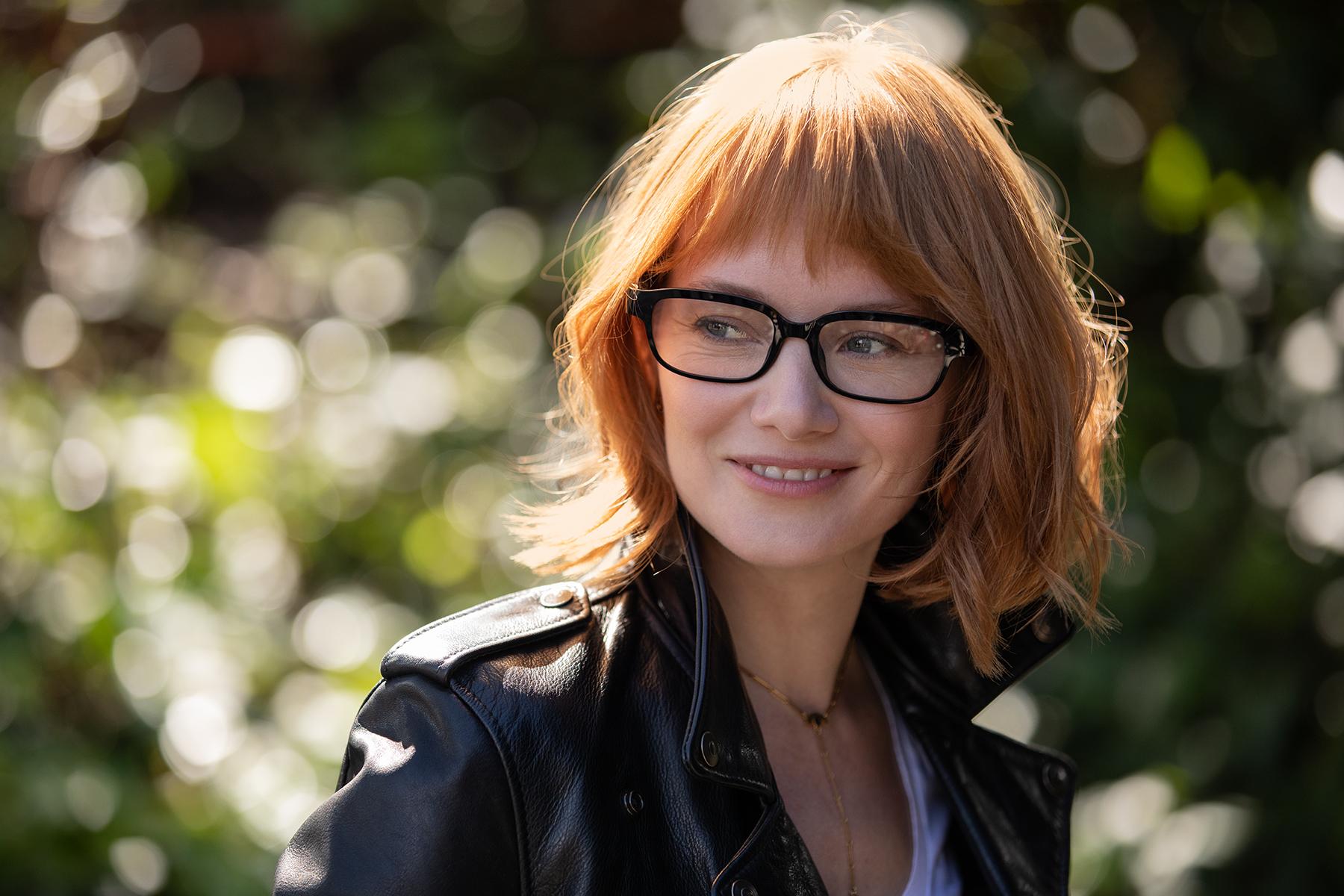 A woman wears Alexa-enabled eyeglasses, called Echo Frames.