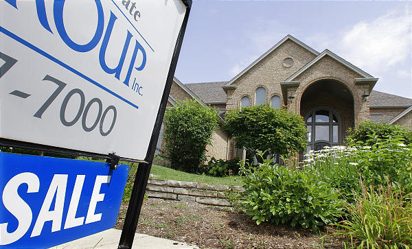 In this photograph taken July 15, 2010, a home is advertised for sale in Springfield, Ill.