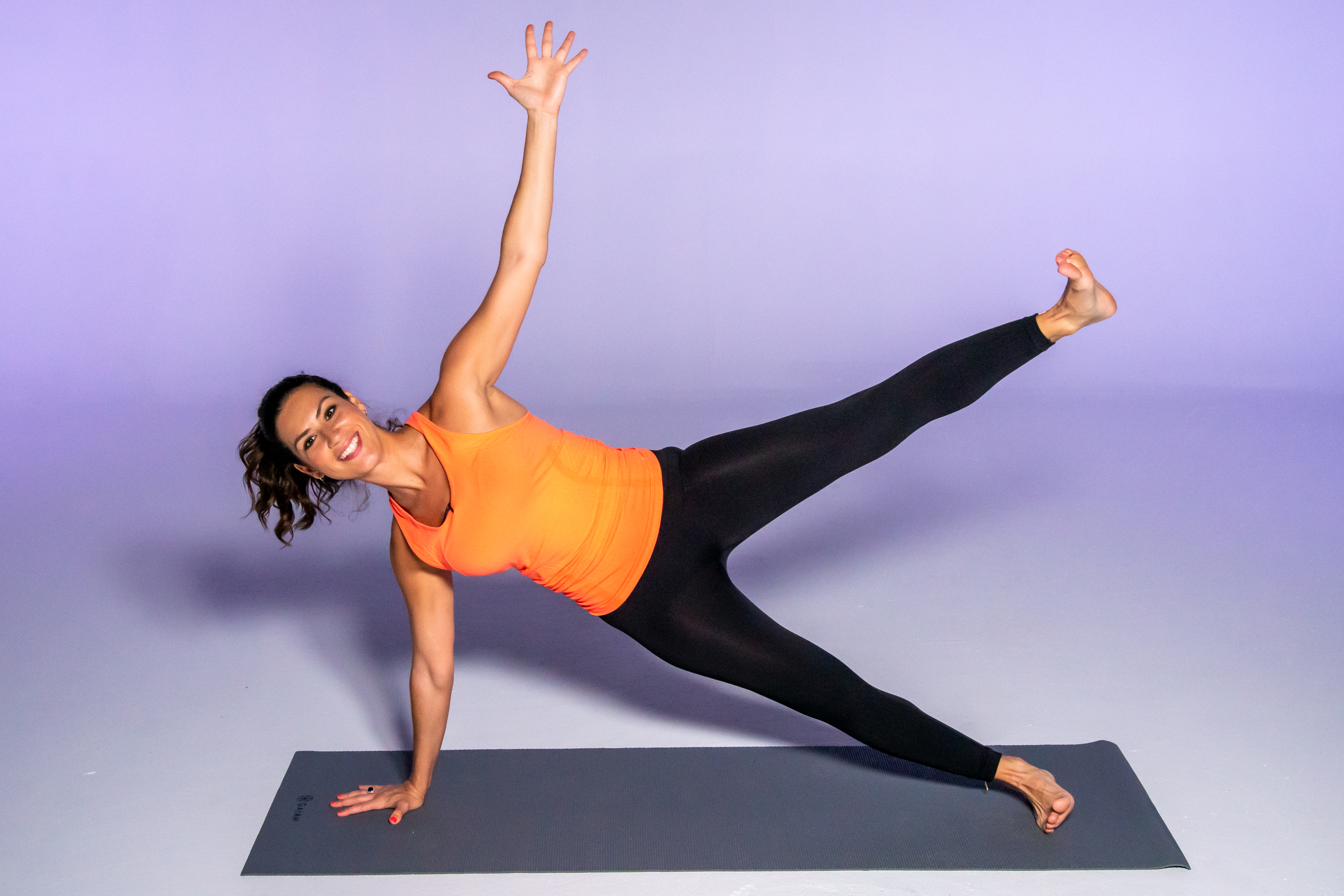 Stephanie Mansour demonstrates a side plank with side leg lift: With both hands on the ground, turn to the left and then lift the left arm up towards the ceiling. Repeat the same thing on the other side side.