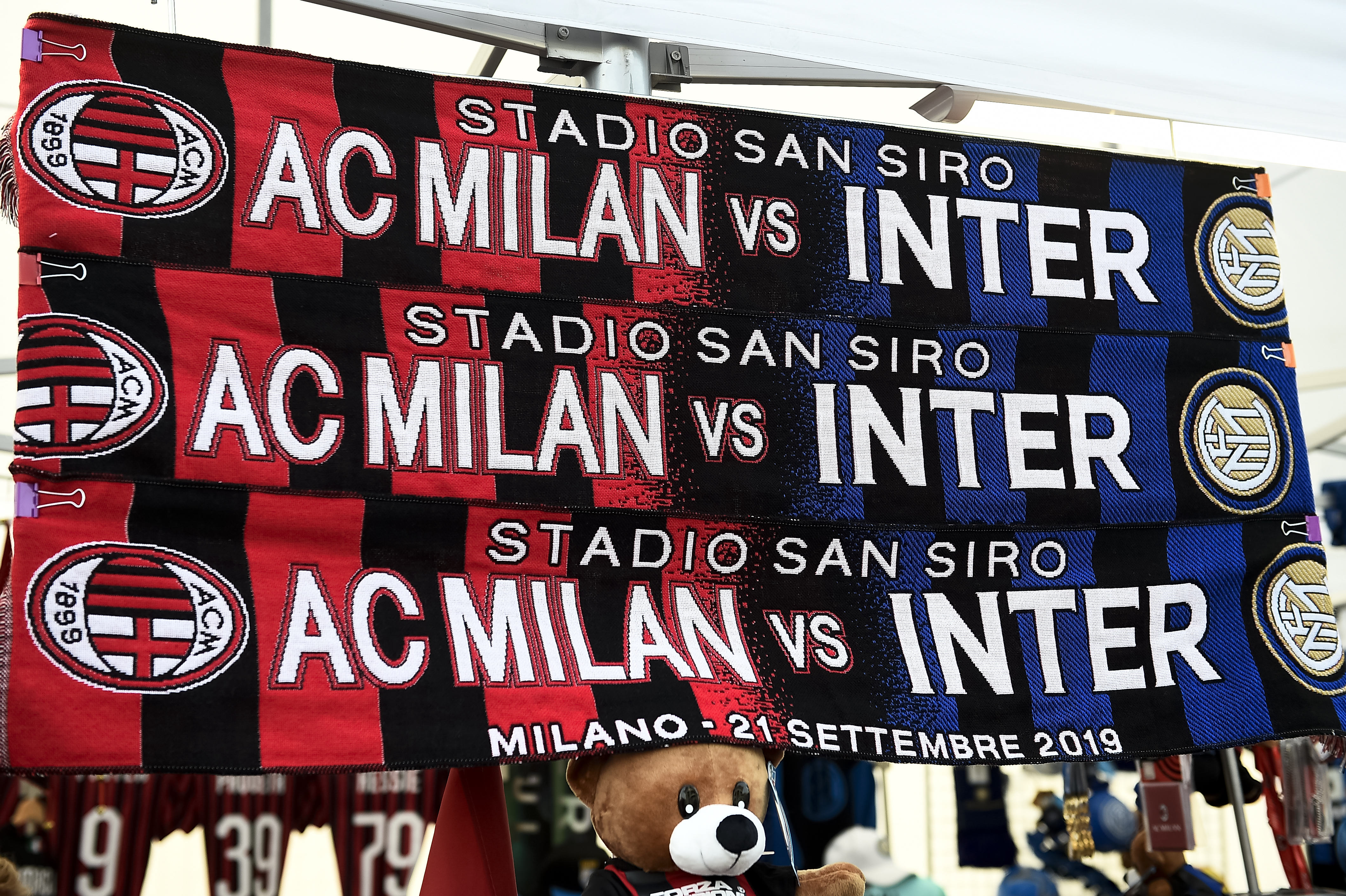 Half and half scarves on sale ahead of the Serie A football...