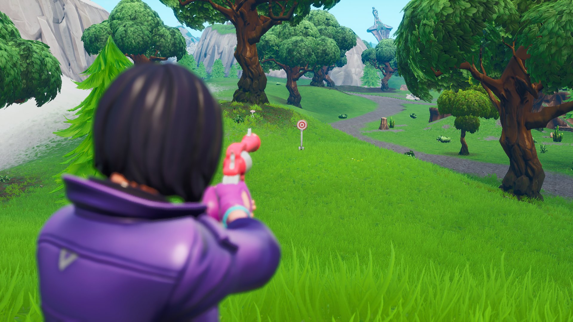 A Fortnite player takes aim at a firing range target in front of them