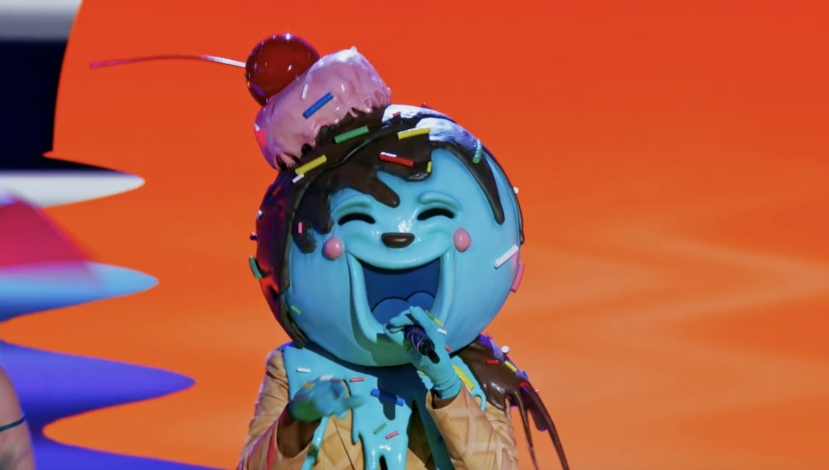 a man in a ice cream suit sings a song
