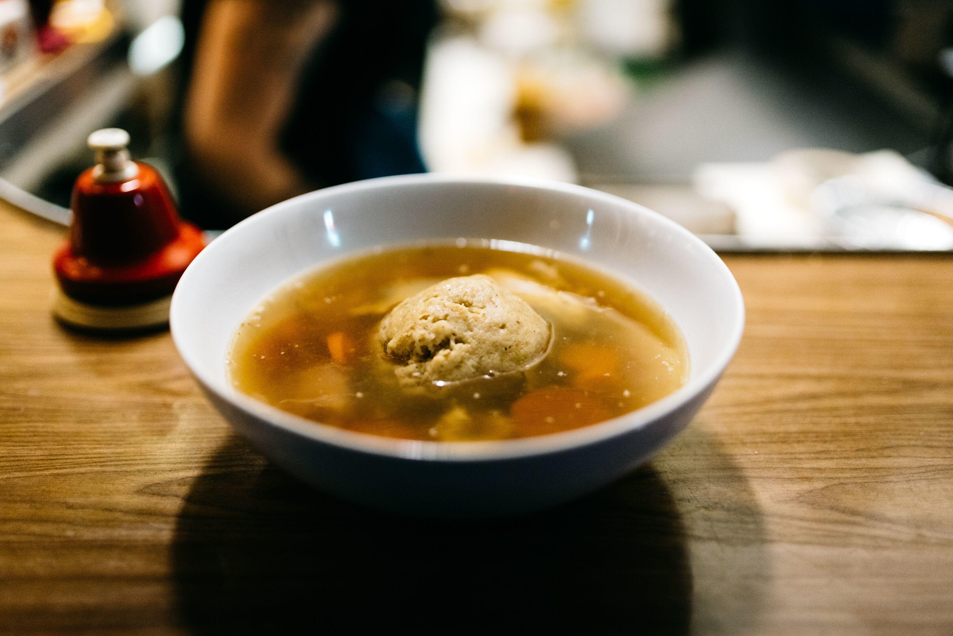 A bowl of matzah ball soup.