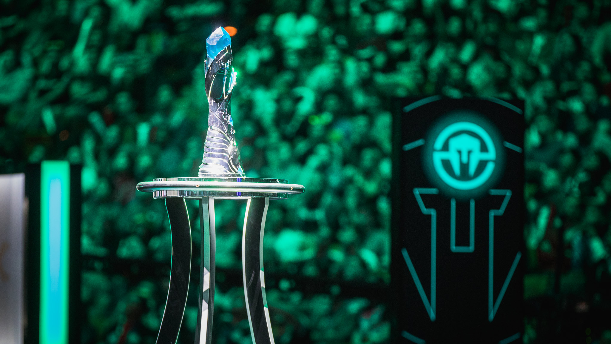 The Immortals logo sits behind a Finals trophy from the 2017 LCS Summer Finals