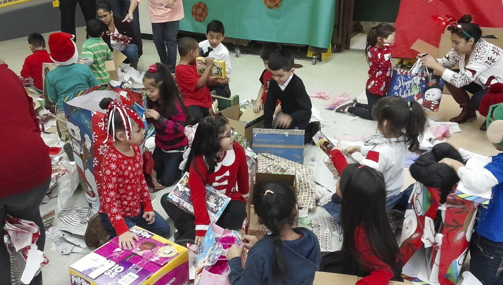 Students at Octavio Paz elementary open their gifts provided through the Chicago Sun-Times' Letters to Santa program at the school's annual holiday party. | Mark Brown/Sun-Times