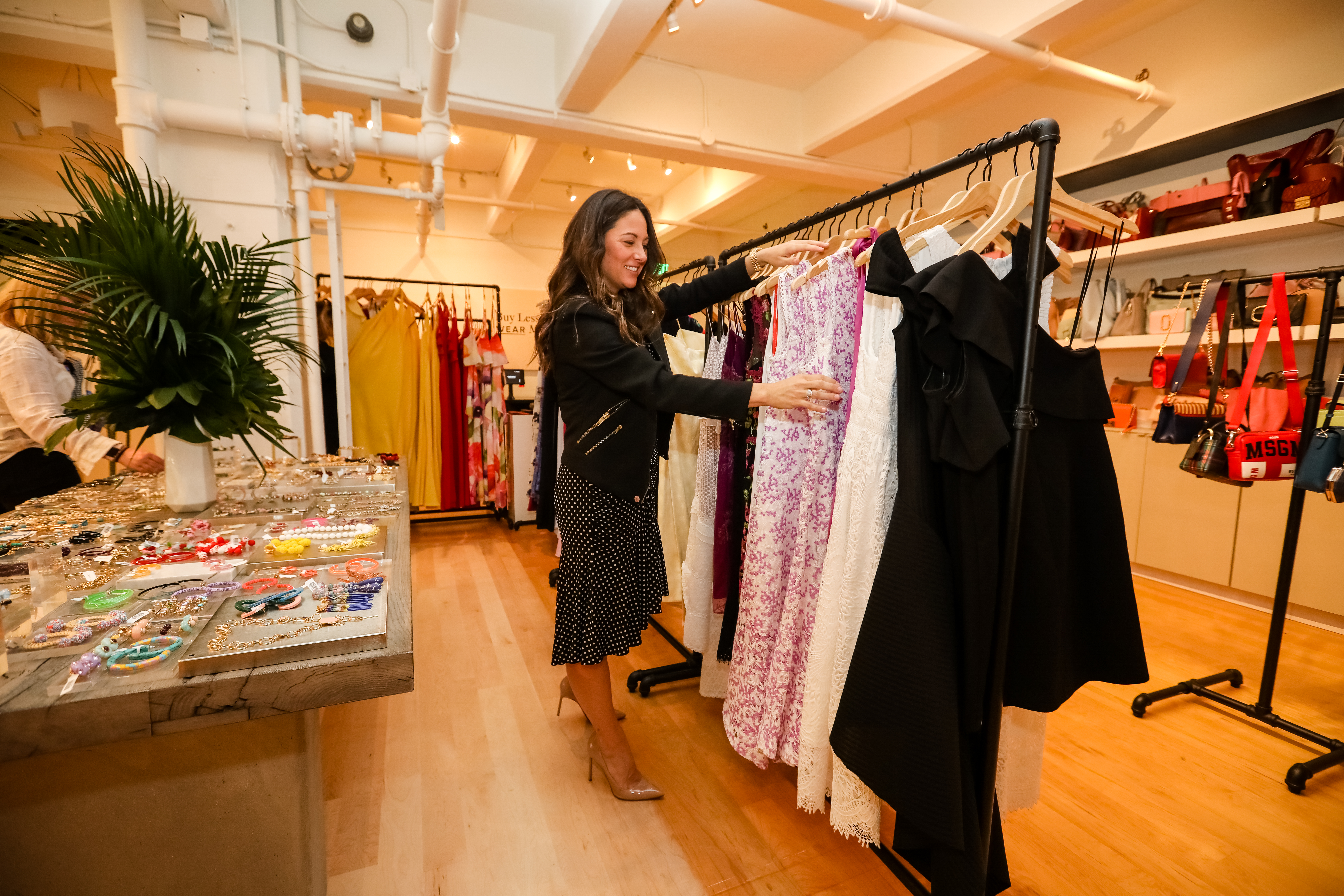 Rent the Runway Chief Operating Officer Maureen Sullivan looks through a rack of dresses inside Rent the Runway's San Francisco store.