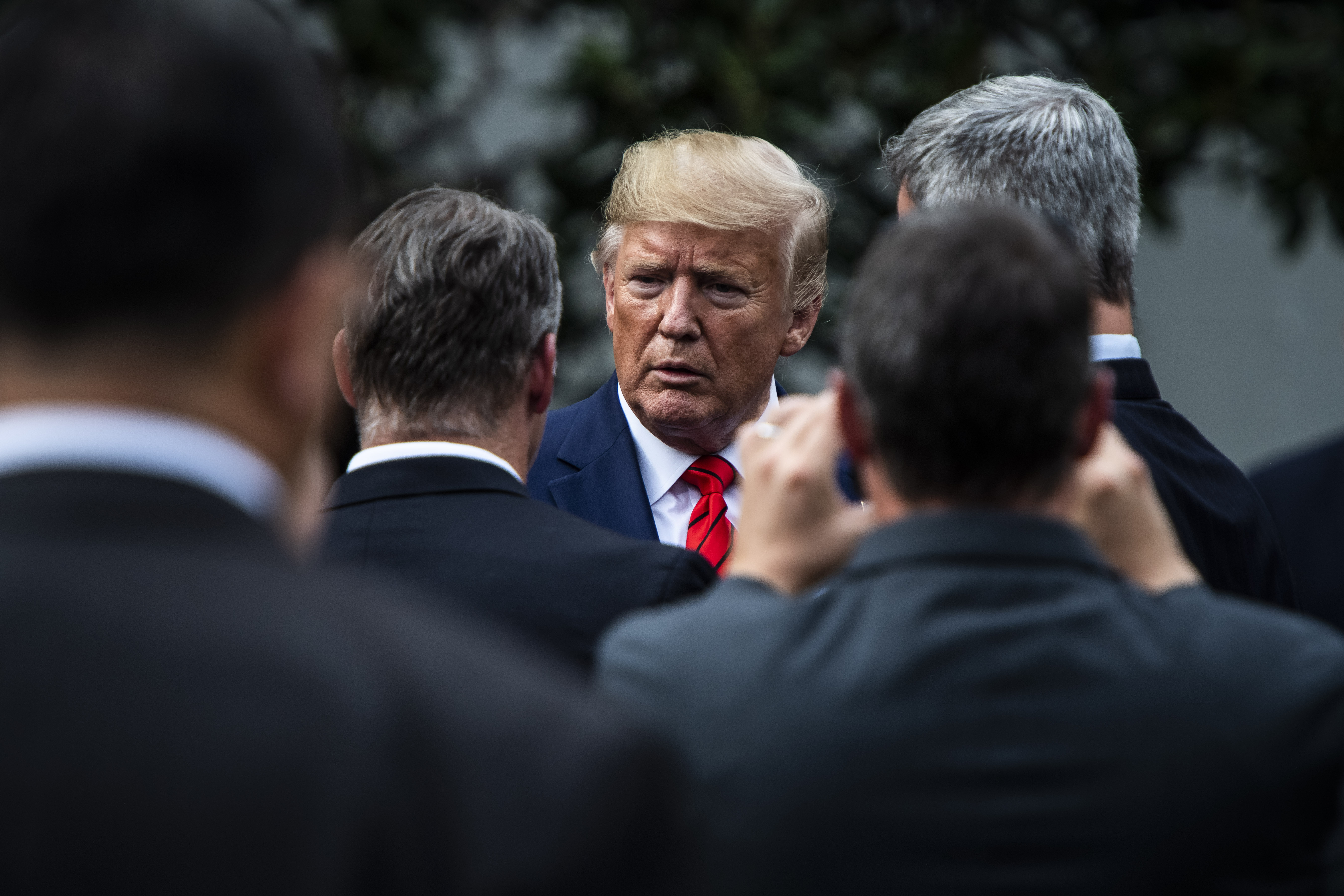 President Donald Trump talks to others as he walks back to the Oval Office of the White House on Thursday, Sept 26, 2019 in Washington, DC.
