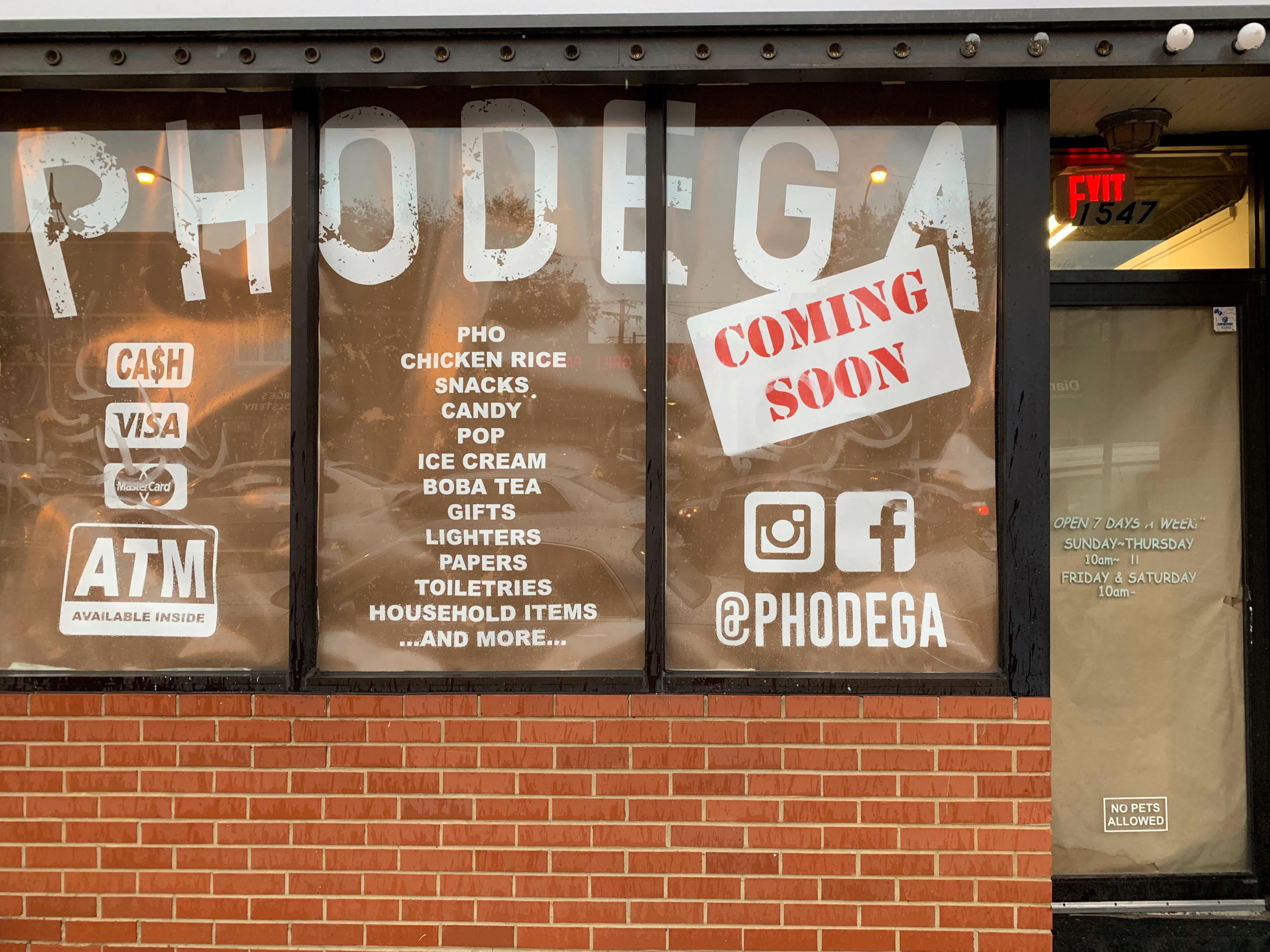 """The exterior of a building. The window reads """"Phodega"""" and has a sign that reads """"coming soon."""""""