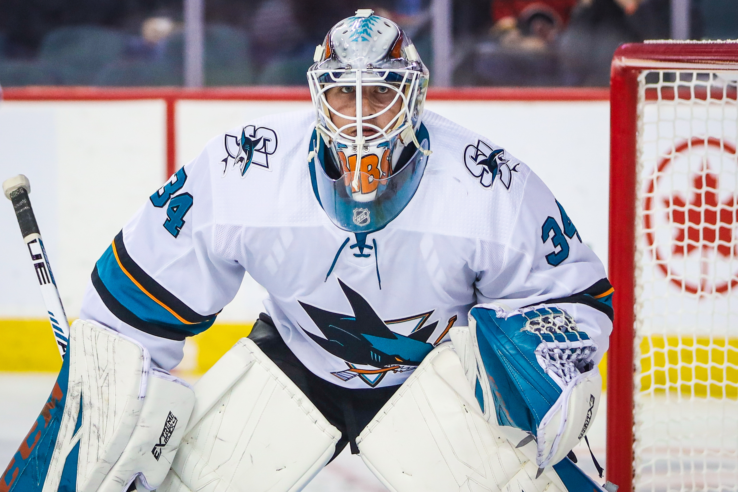 Sep 18, 2019; Calgary, Alberta, CAN; San Jose Sharks goaltender Antoine Bibeau (34) guards his net against the Calgary Flames during the first period at Scotiabank Saddledome.