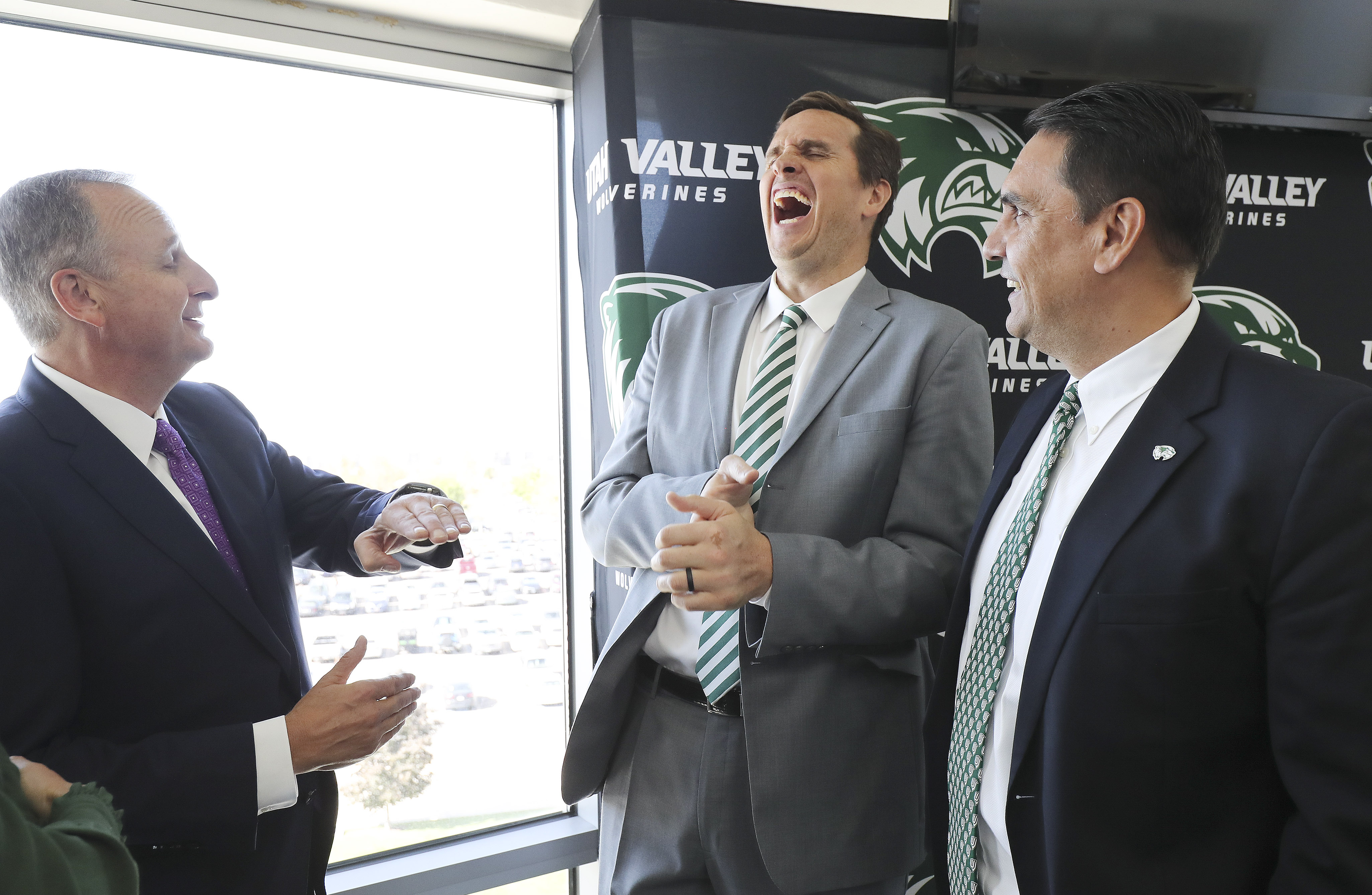 Utah Valley University basketball coach Mark Madsen, center, laughs while speaking with doTerra founding executive Mark Wolfert, left and UVU volleyball coach Sam Atoa after the company announced on Friday, Sept. 27, 2019, that it would donate $17.7 million to the Orem university over the next 10 years.