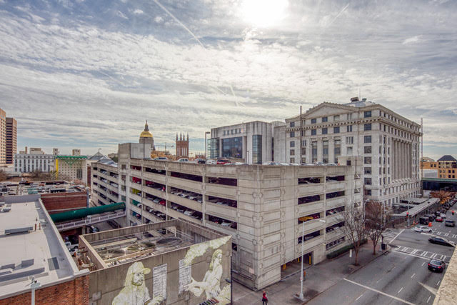 An aerial photo of a parking garage structure and other buildings in downtown Atlanta.