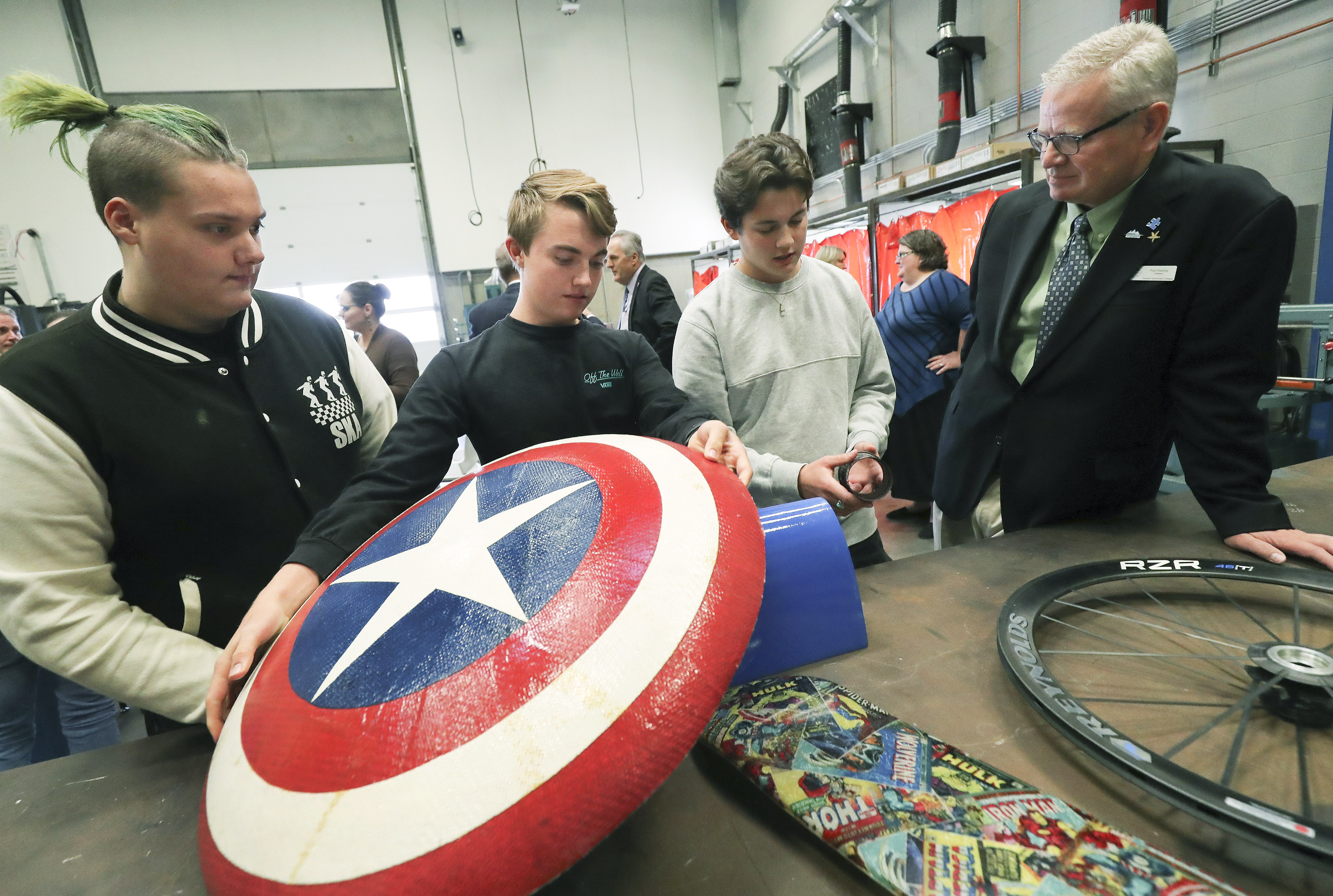 Tooele Technical College students Raven Robb, Zane Manzione and Peter Webb look over composite projects with school President Paul Hacking in Tooele on Wednesday, Sept. 11, 2019. The Utah Aerospace Pathways program is expanding at the college and the Tooele County School District.