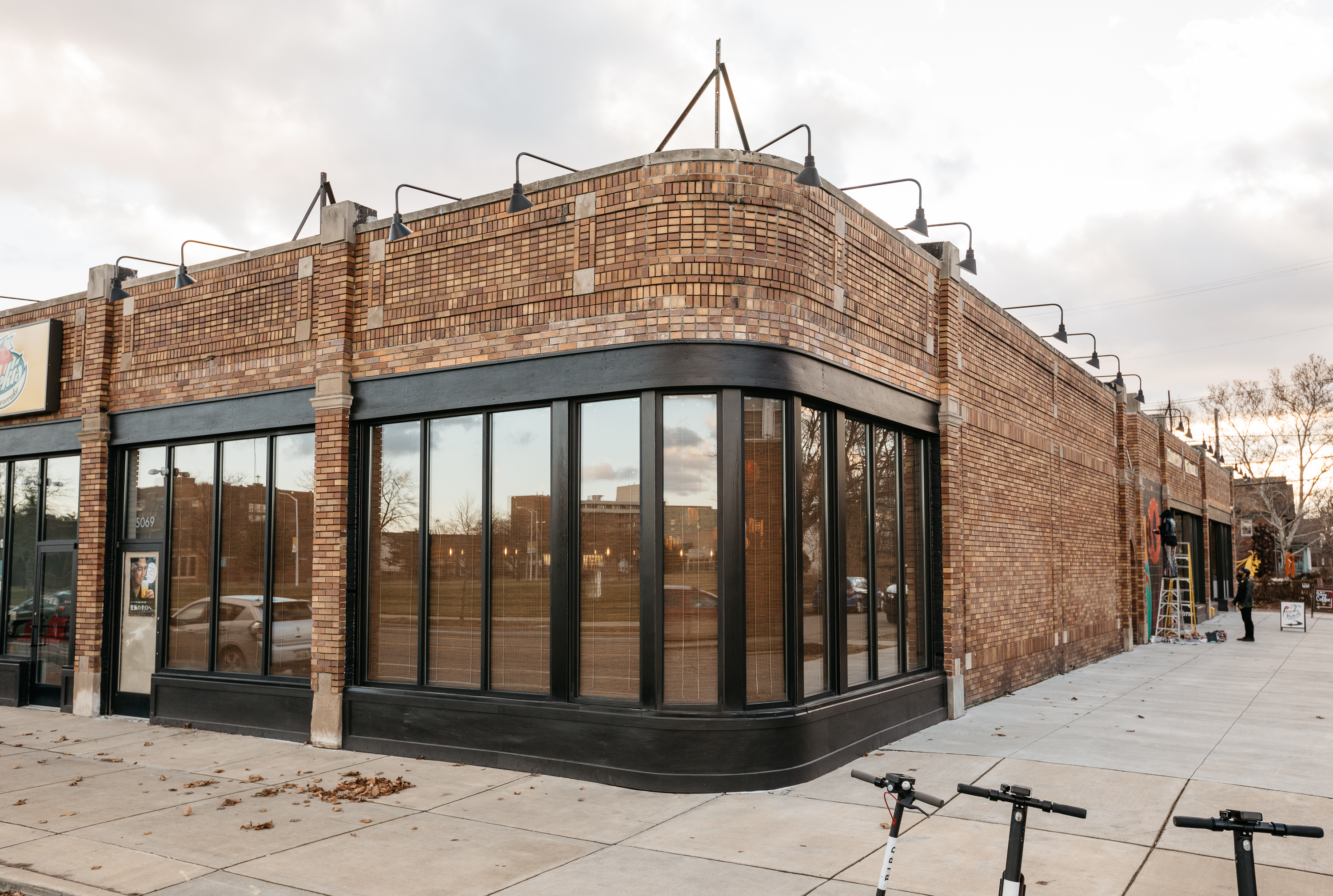 The shuttered Izakaya Katsu is located in a corner brick building with windows wrapping around the curve on Trumbull and Putnam in Woodbridge.