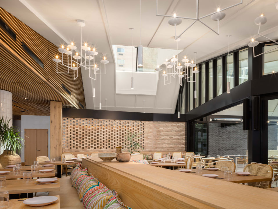 restaurant with modern chandeliers and banquets