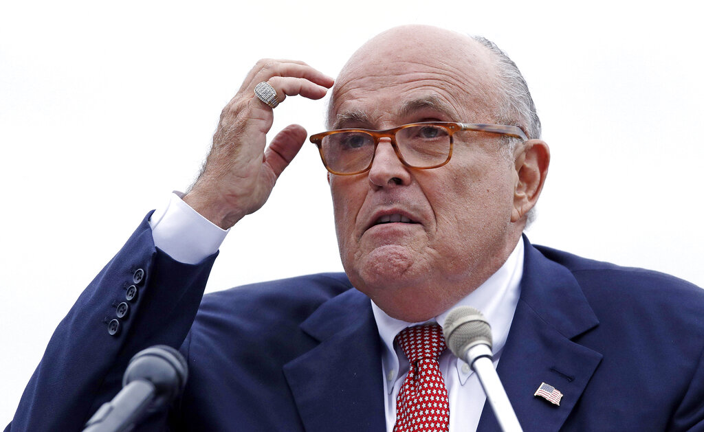Rudy Giuliani addresses a gathering during a campaign event in Portsmouth, N.H.