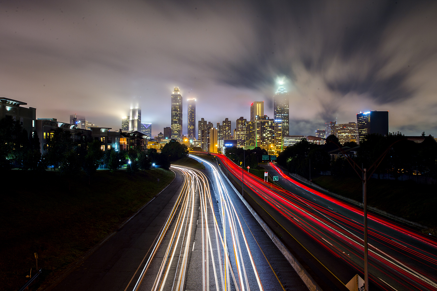 Traffic streams in and out of downtown Atlanta on a recent, cloudy night.