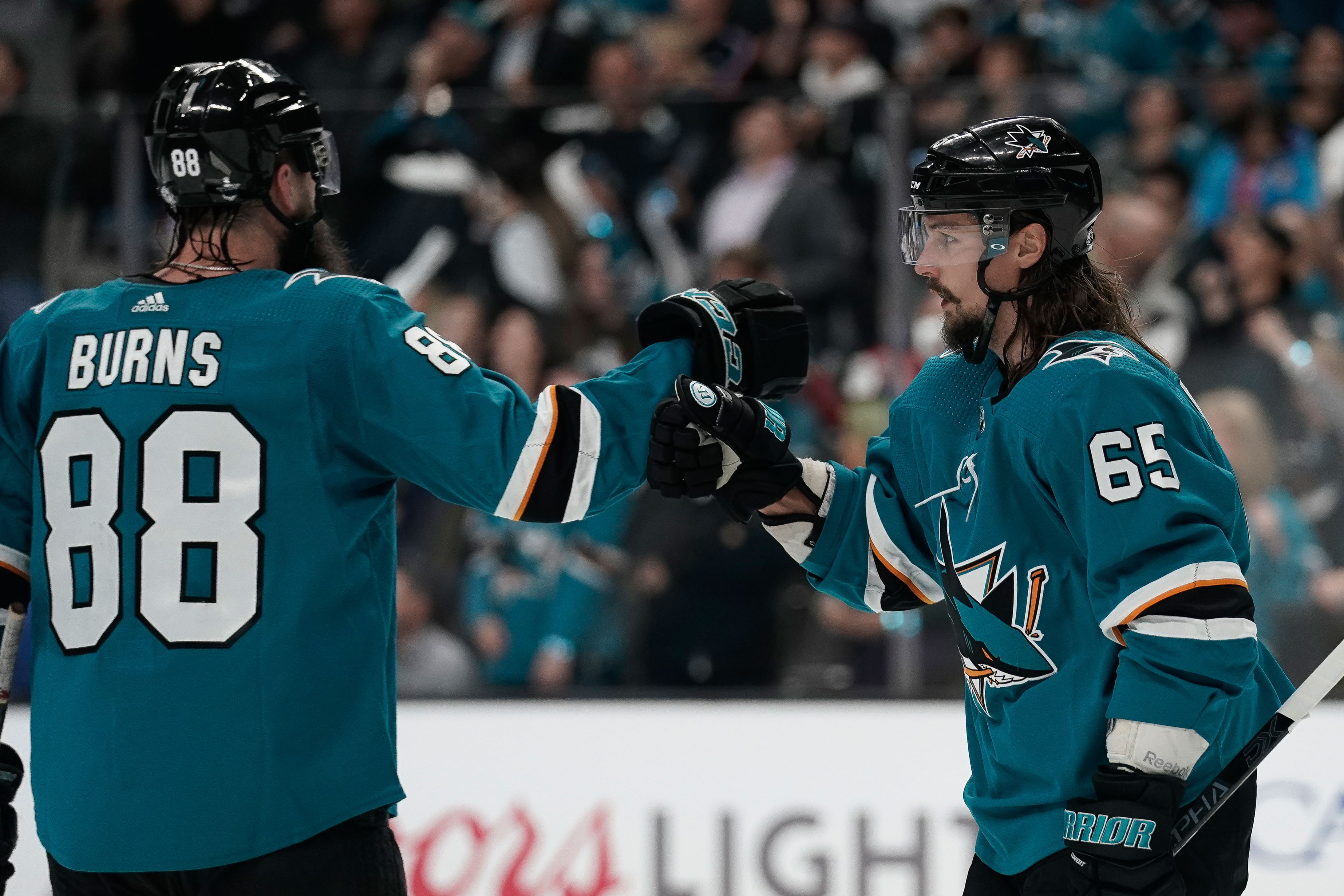 San Jose Sharks defenseman Brent Burns (88) congratulates defenseman Erik Karlsson (65) against the Vegas Golden Knights during the first period in game two of the first round of the 2019 Stanley Cup Playoffs at SAP Center at San Jose.