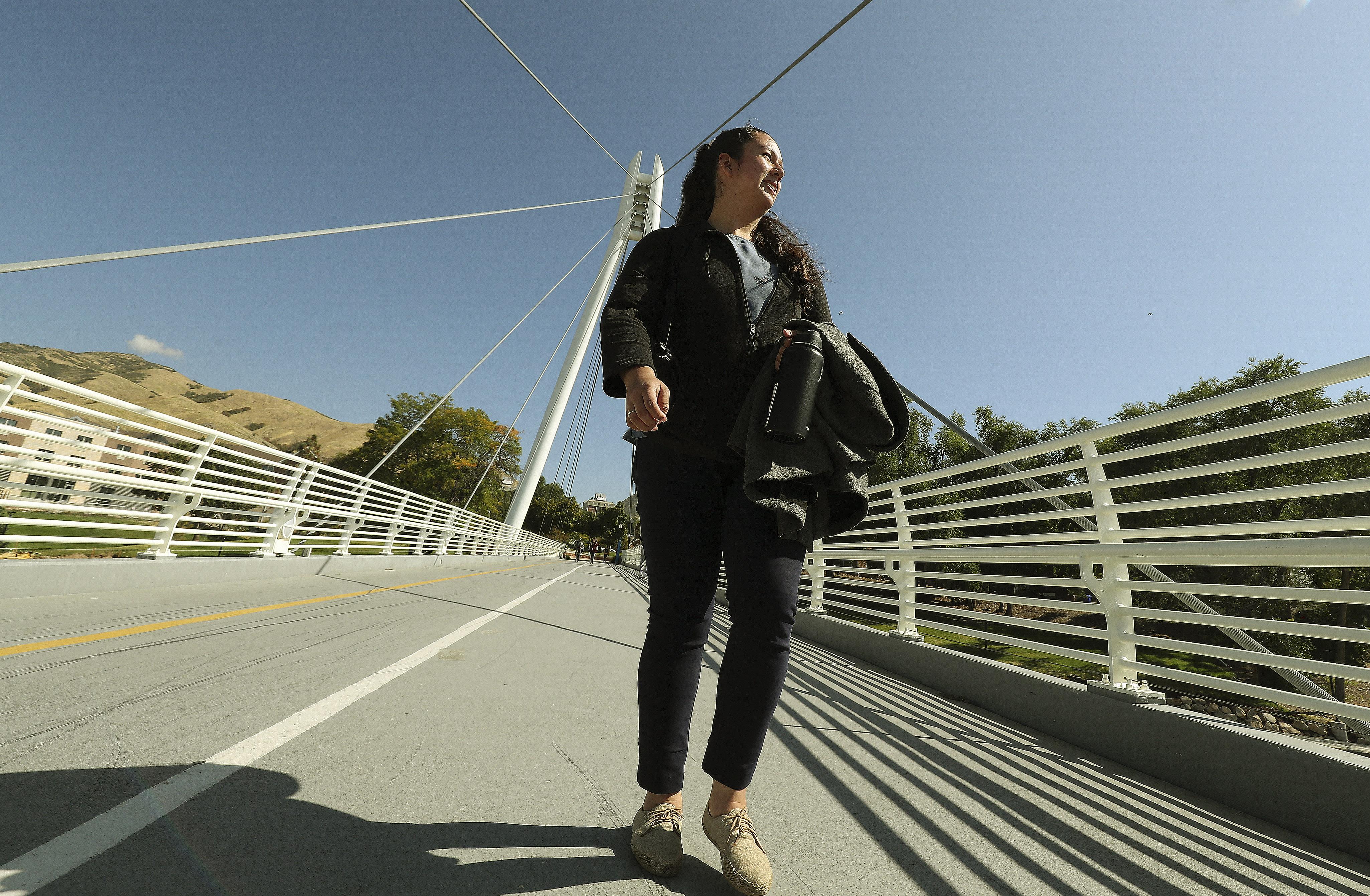 University of Utah student Sinndy Rios walks across the George S. Eccles 2002 Legacy Bridge on campus in Salt Lake City on Tuesday, Oct. 1, 2019.
