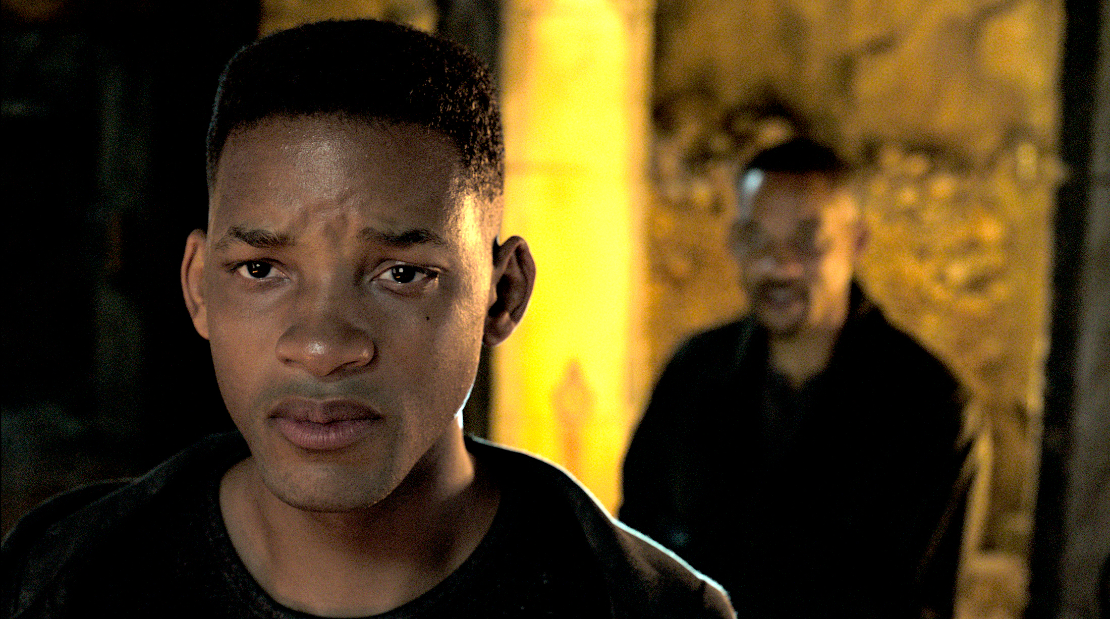 Will Smith stands behind a Young Will Smith who is near tears during an interrogation