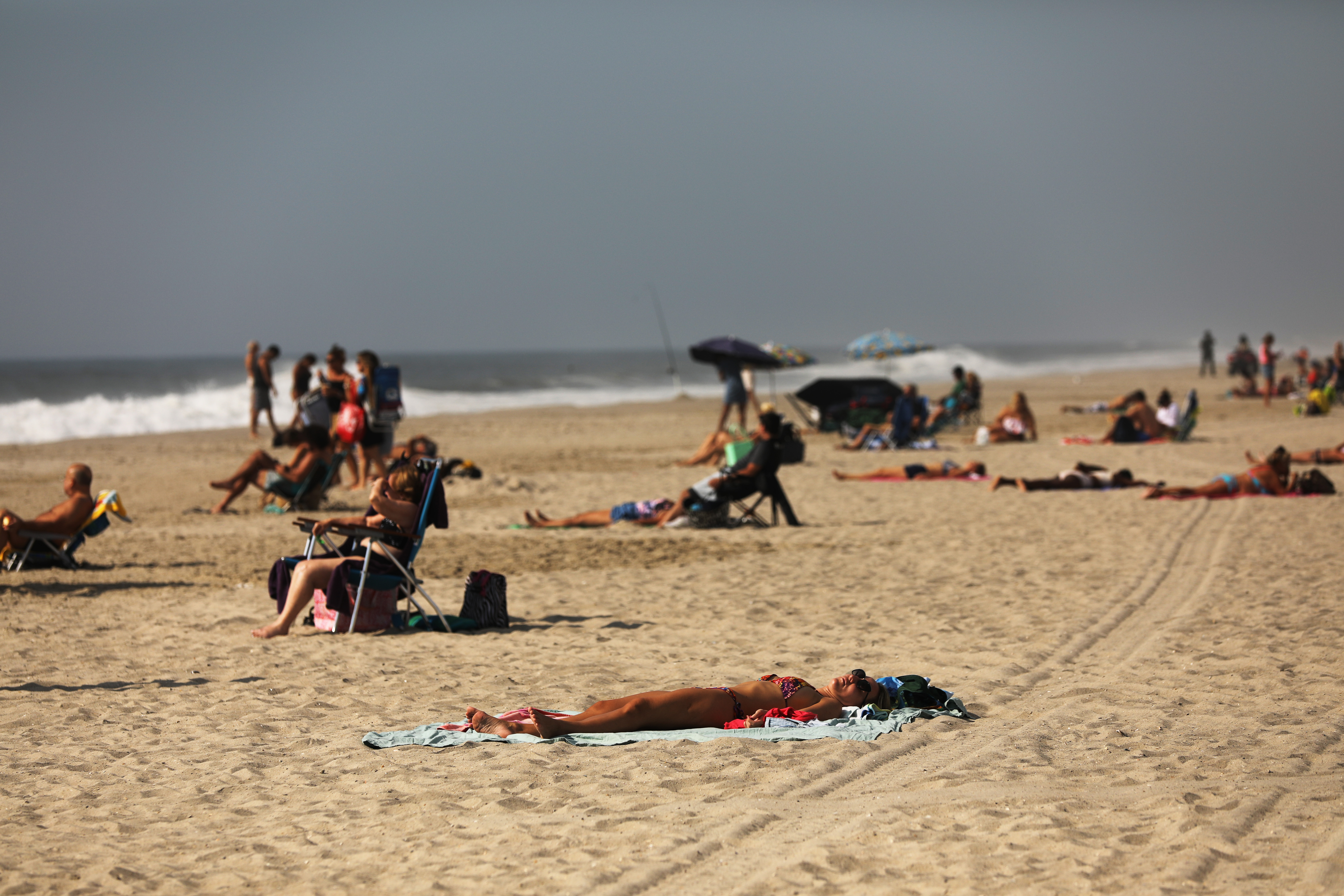 Unseasonably Hot Weather In October Continues To Draw Swimmers To New York Beaches