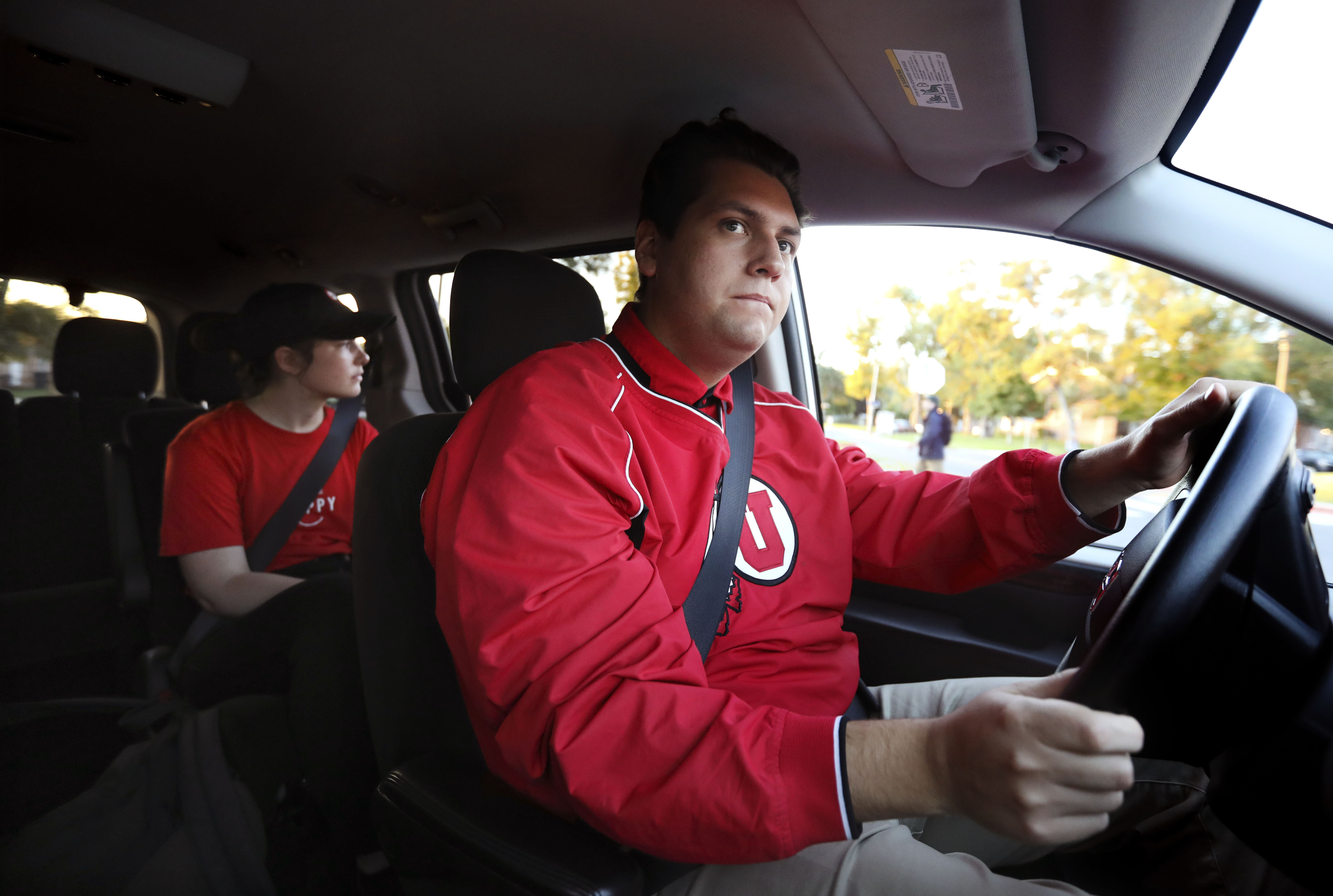 SafeRide driver Robert Witkop drives third-year student Hannah Smith to her apartment at the Shoreline Ridge student housing in Salt Lake City on Wednesday, Oct. 2, 2019. SafeRide provides a safe and reliable mode of transportation on campus to ensure safety during night hours. The university says the service is available to anybody in the university community, but they stress it is especially meant to serve students on campus at night who need a safe ride to a parking lot, student housing or to another building on campus. The idea was brought forth by students on the University's Safety Task Force assembled by U. President Ruth Watkins after student-athlete Lauren McCluskey was murdered on campus in October.