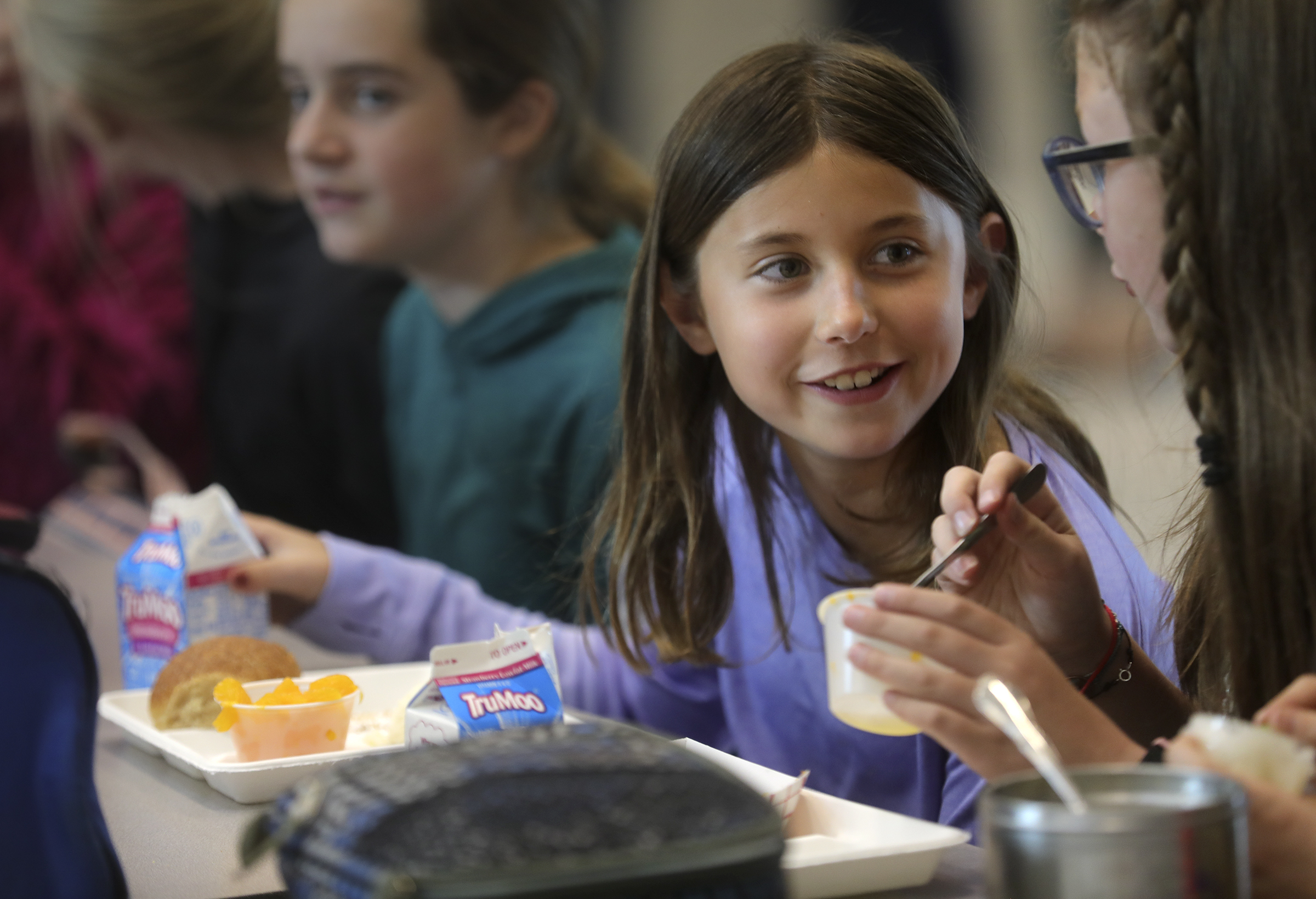Evelyn Fisher talks with Annabelle Cheney while they eat off of compostable lunch trays at Butler Elementary School in Cottonwood Heights on Wednesday, Oct. 2, 2019.The two encouraged the school board to switch to the more eco-friendly trays.
