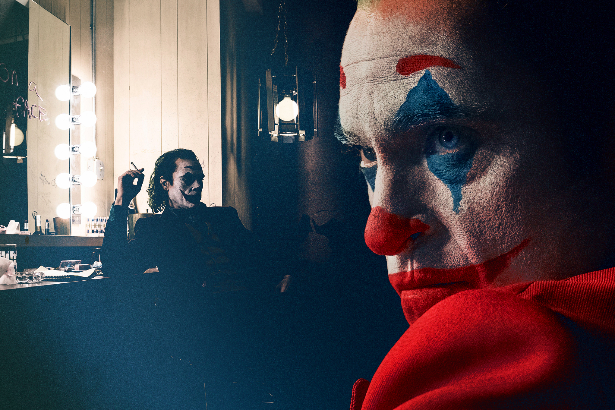 Photo composition featuring close up of Joaquin Phoenix as the Joker and him in his dressing room