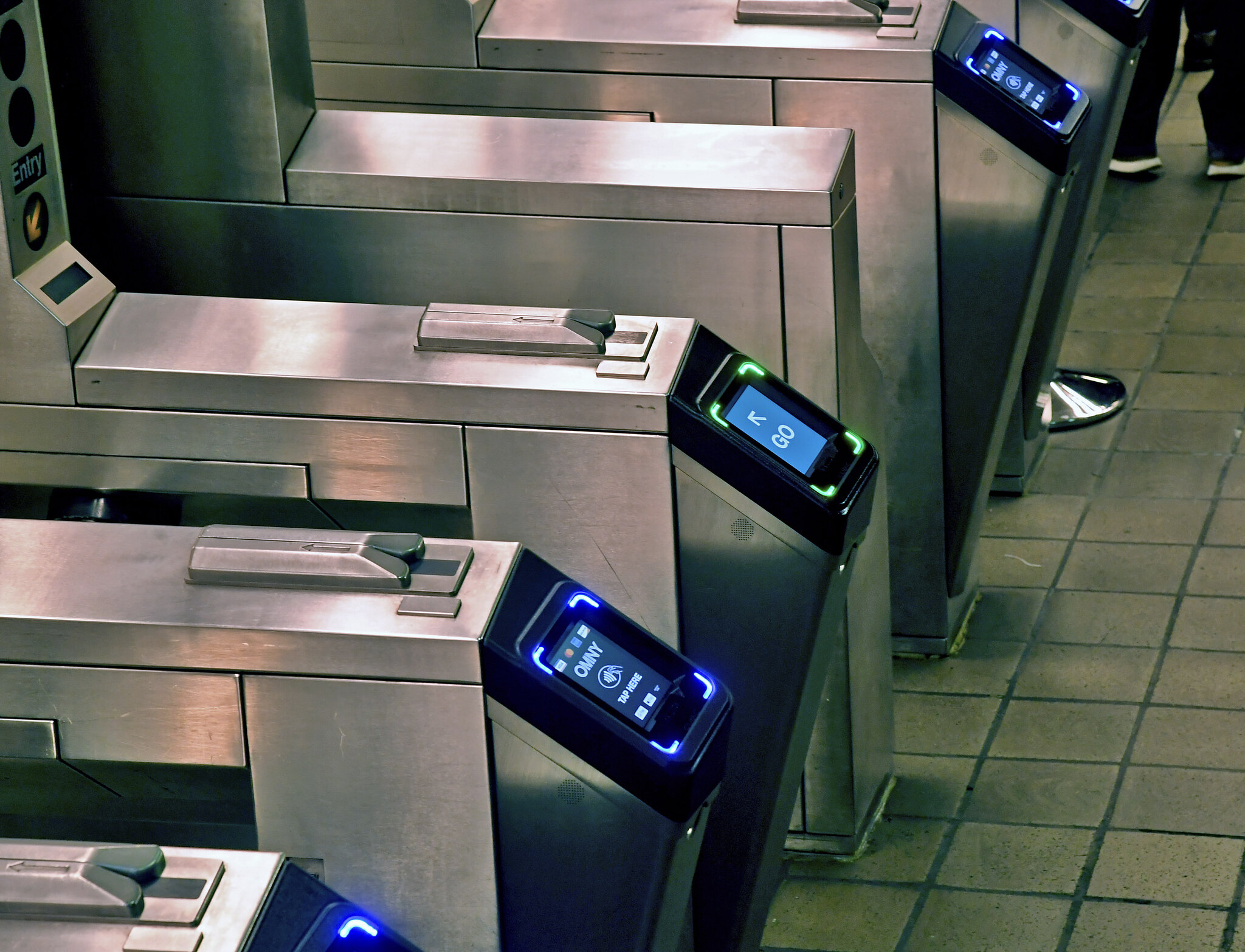 New York City subway turnstiles equipped with new contactless payment readers.