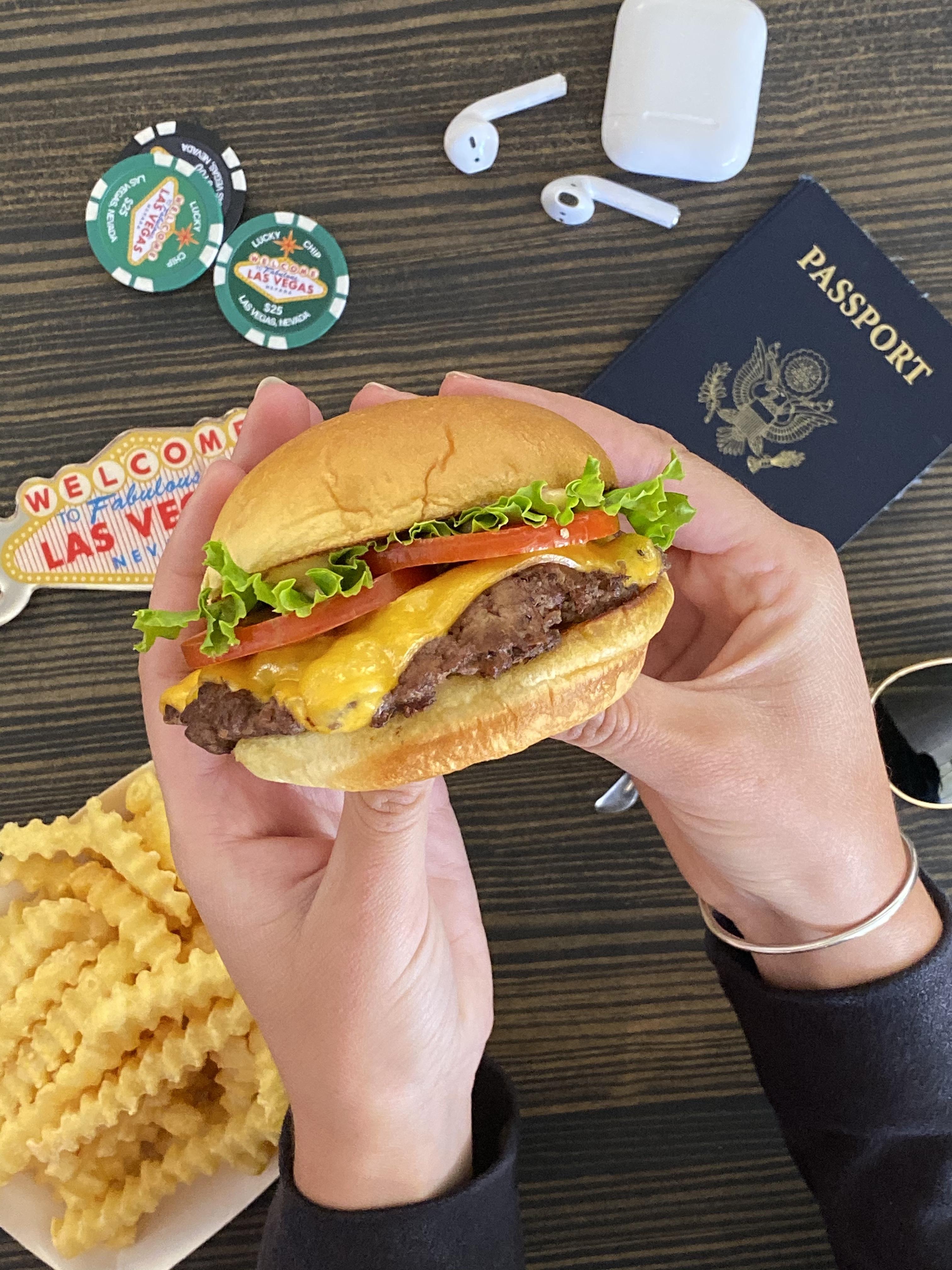 Hands holding a burger