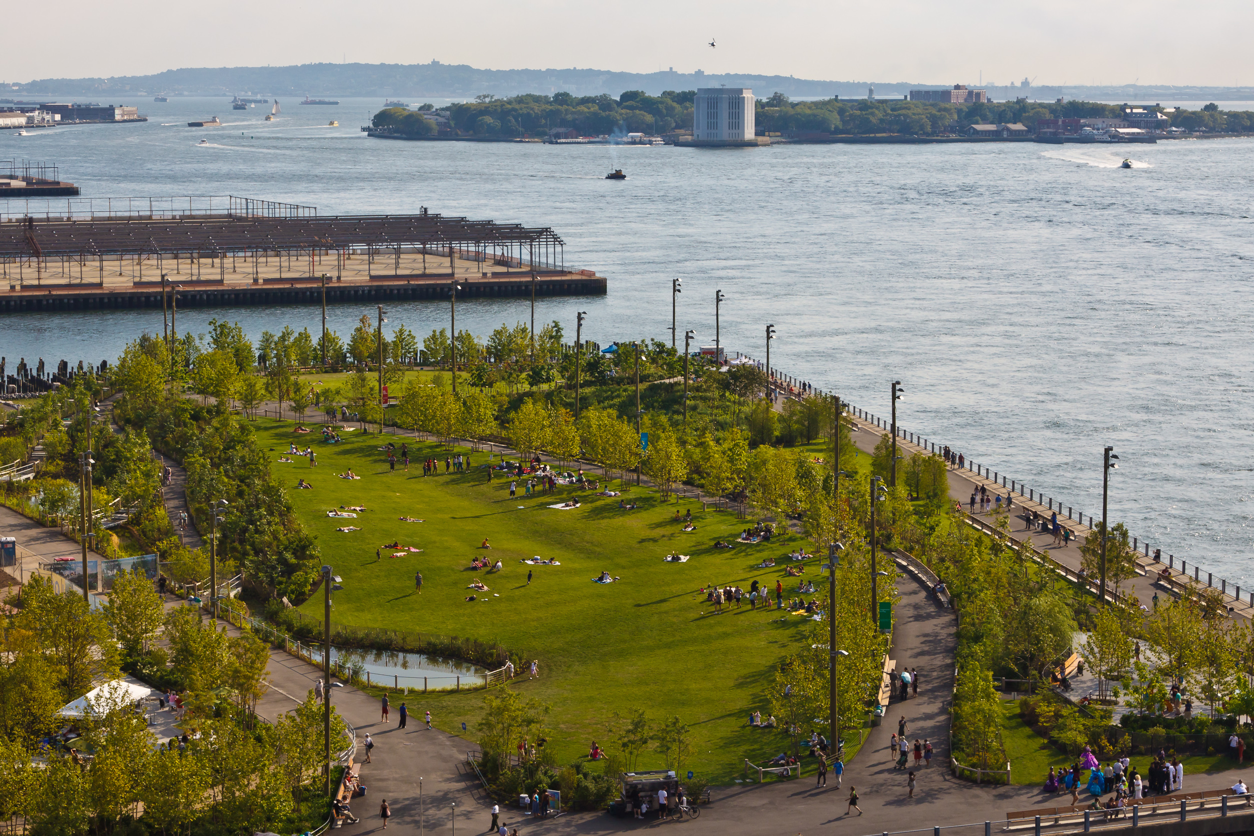 A new waterfront park in Brooklyn, with a view of Governors Island in the distance.