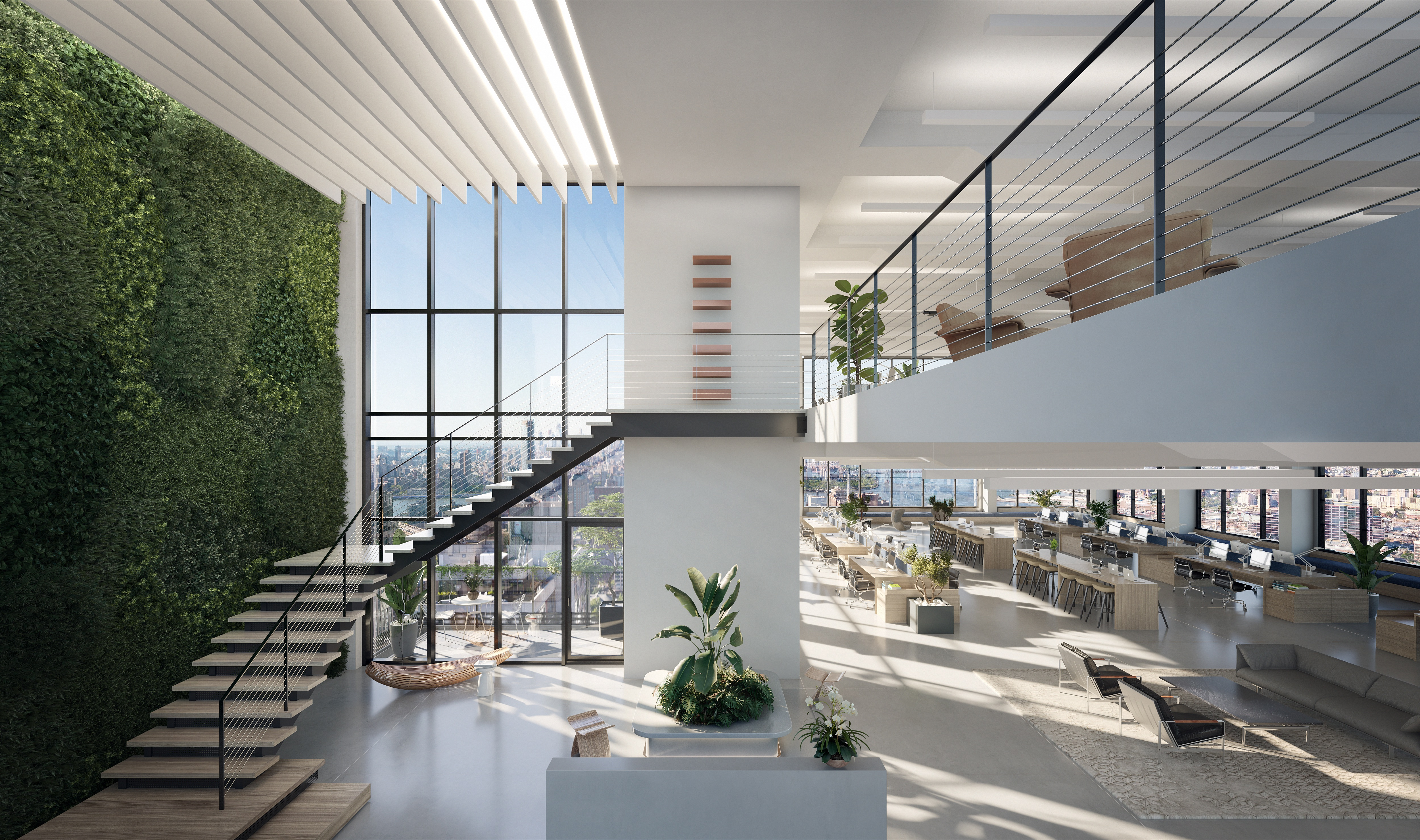An office space with a large staircase large windows, and a wall filled with plants.