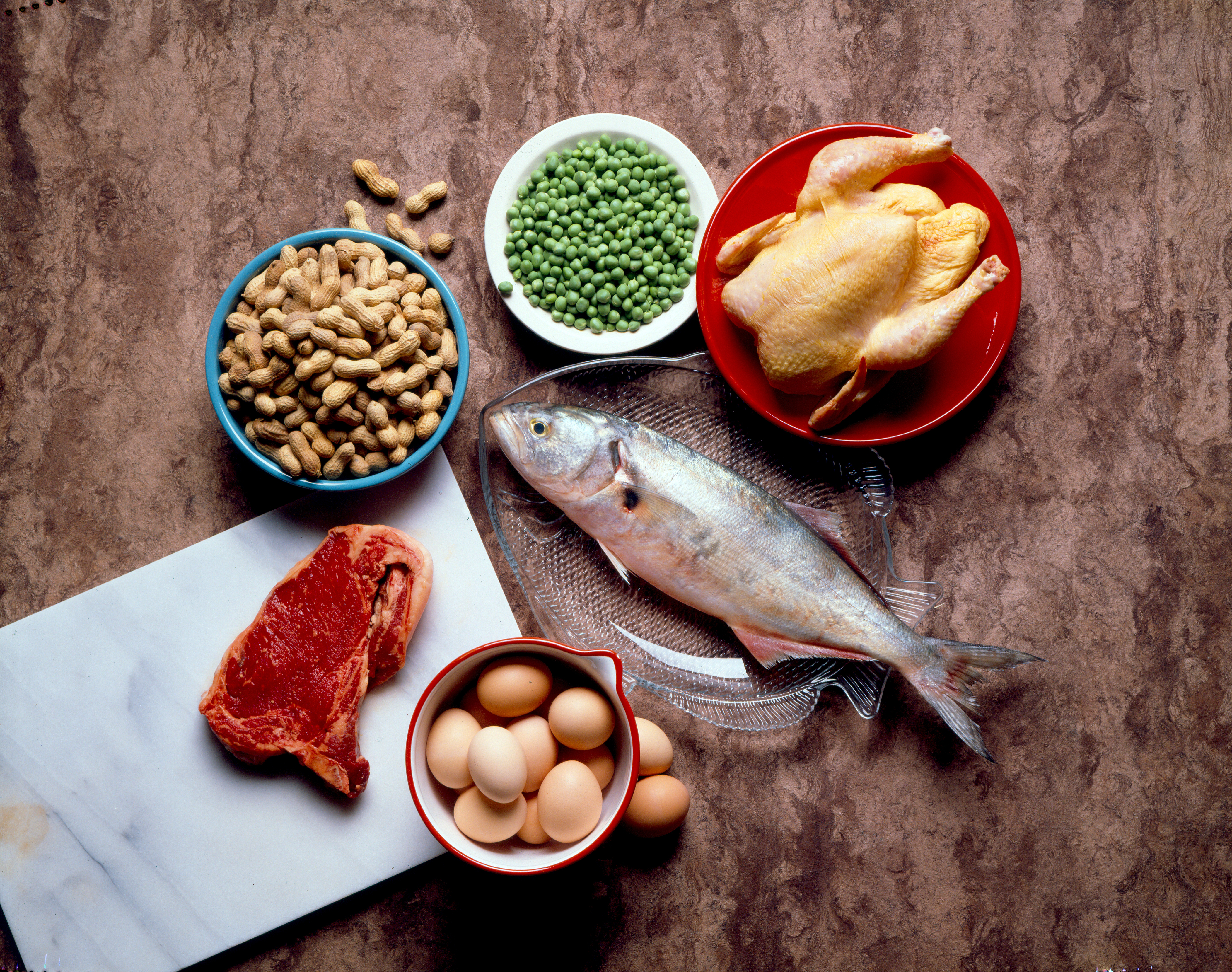 Still life of protein-rich foods, including meat.