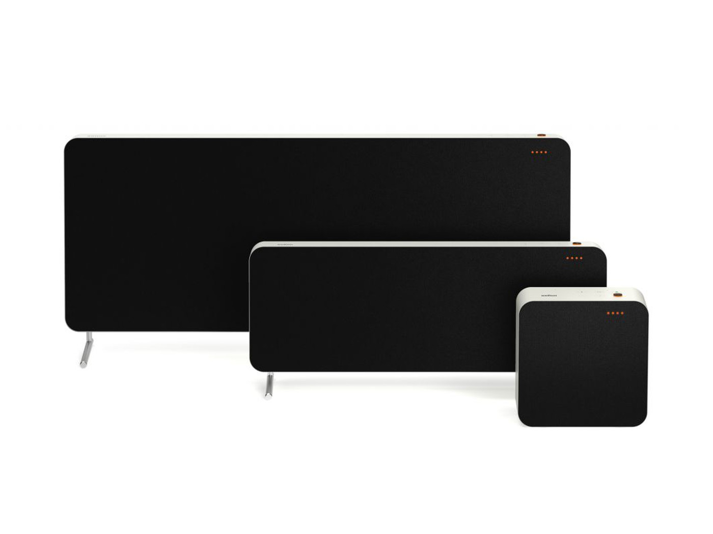 Three black speakers lined up in a row. The smallest is a square speaker on the right, while the other two sit behind it with spindle legs.