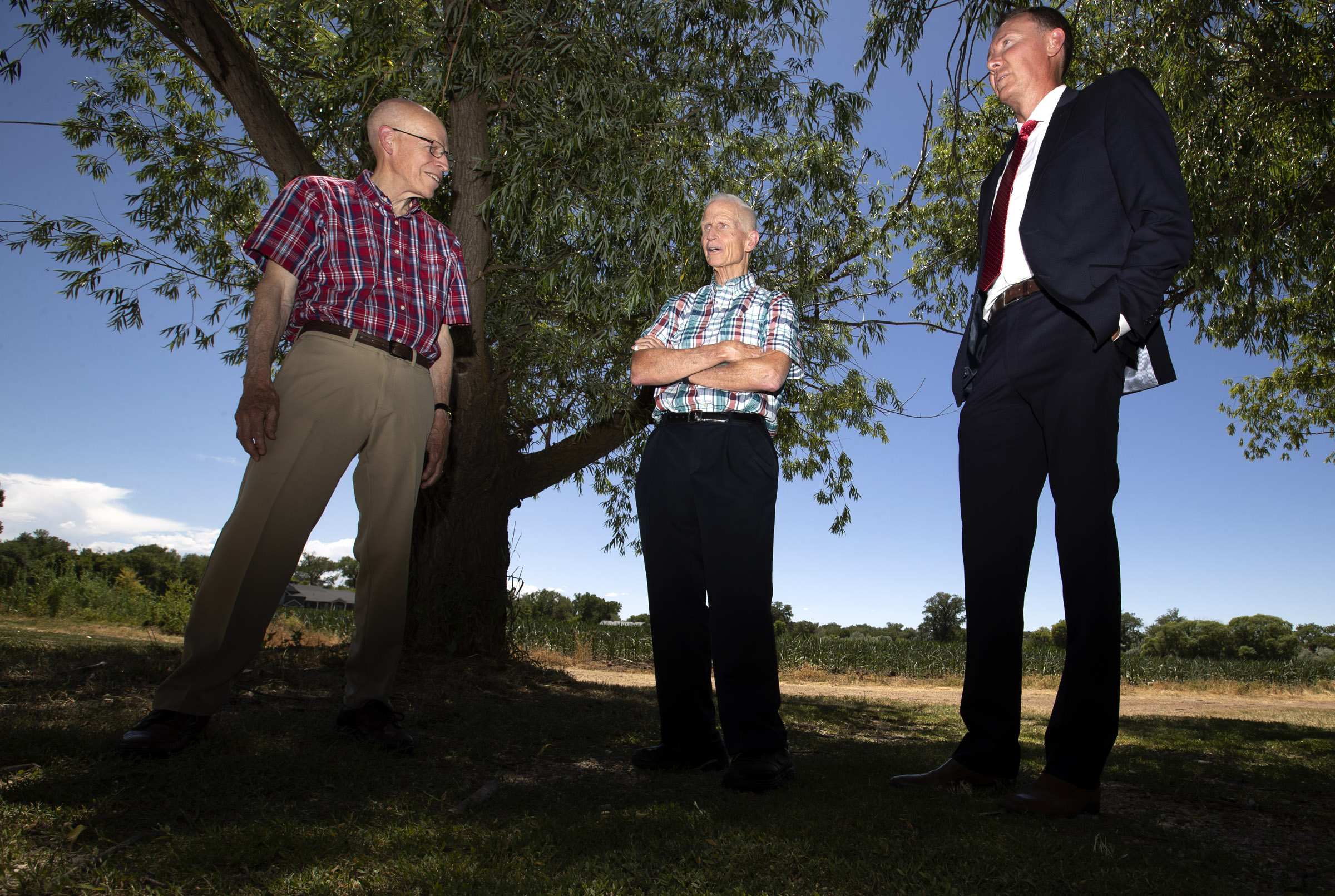 """Marriott Hotel heir Dick Marriott, center, talks with his cousin, Russell """"Tooey"""" Marriott, left, and Bill Morris, administrator and legal counsel for Marriott-Slaterville, on Thursday, July 11, 2019, as they look at historic sites in the Weber County town where J. Willard Marriott was born and raised."""