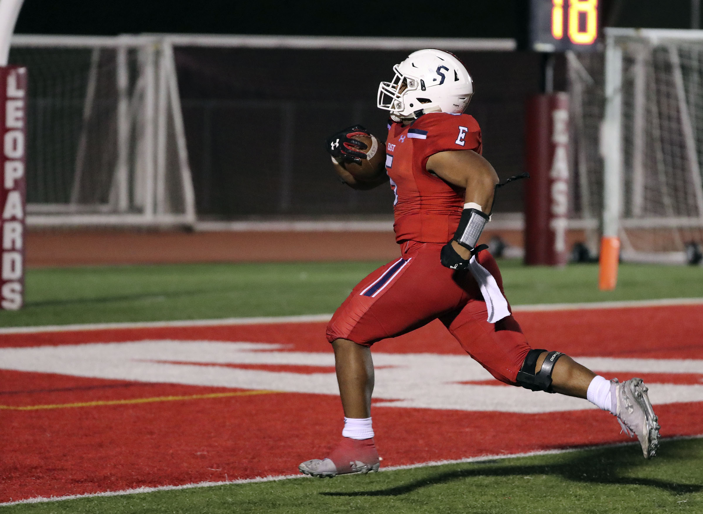 East High's Sione Angilau scores a touchdown during a football game against Herriman at East High School in Salt Lake City on Friday, Oct. 4, 2019. East won 13-10.