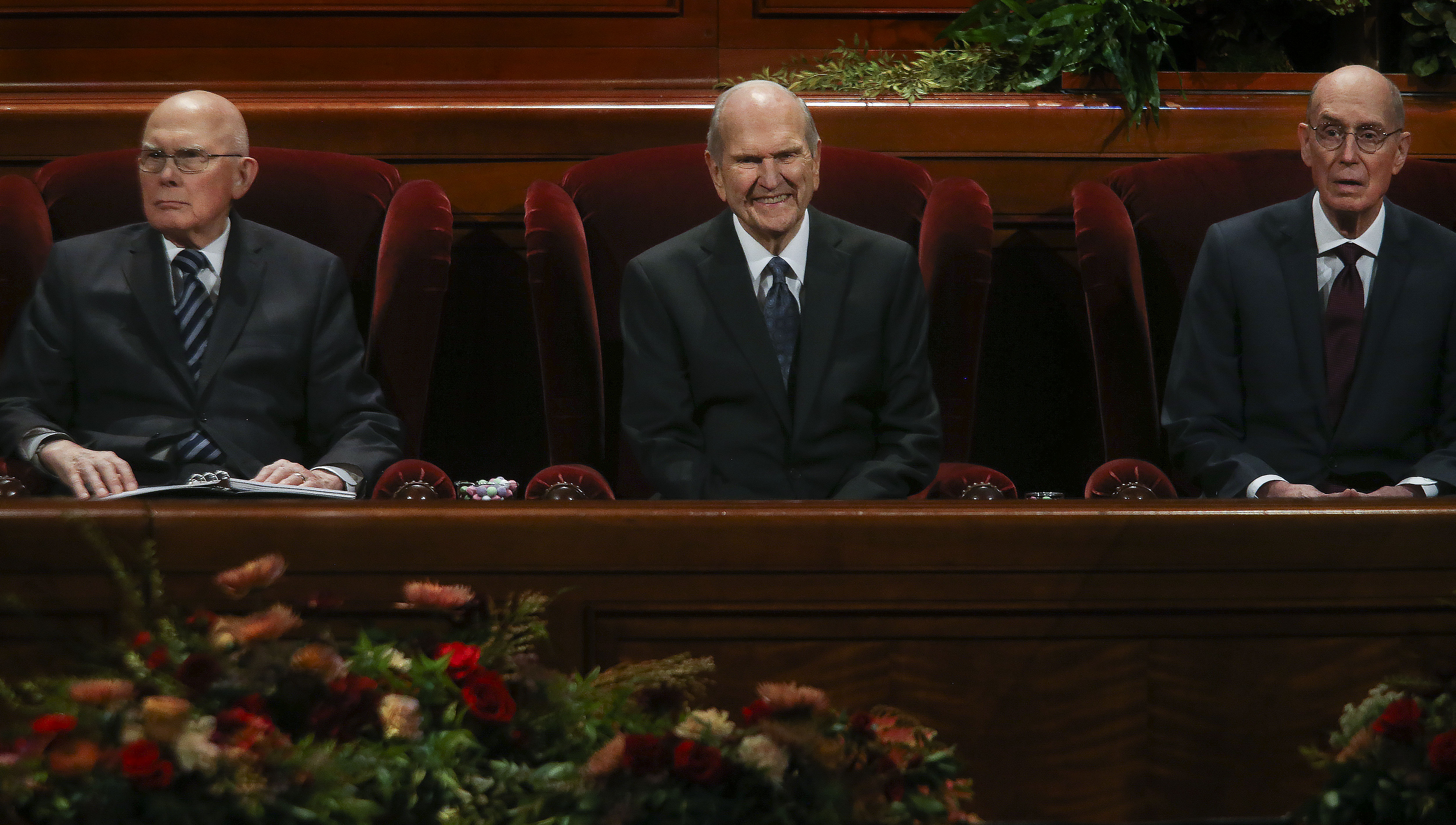 President Russell M. Nelson, of The Church of Jesus Christ of Latter-day Saints, center, and his counselors, President Dallin H. Oaks, first counselor in the First Presidency, left, and President Henry B. Eyring, second counselor in the First Presidency, right, wait for the start of the Sunday afternoon session of general conference in the Conference Center in Salt Lake City on Sunday, Oct. 6, 2019.