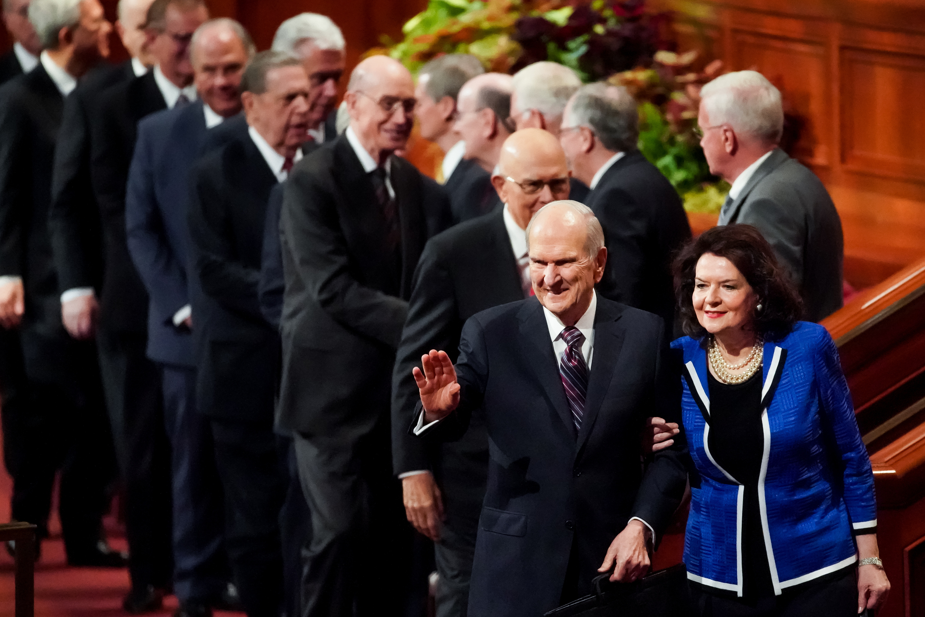 President Russell M. Nelson waves as he and his wife, Sister Wendy Nelson, exit at the conclusion of the Saturday morning session of the 189th Semiannual General Conference of The Church of Jesus Christ of Latter-day Saints at the Conference Center in Salt Lake City on Saturday, Oct. 5, 2019.