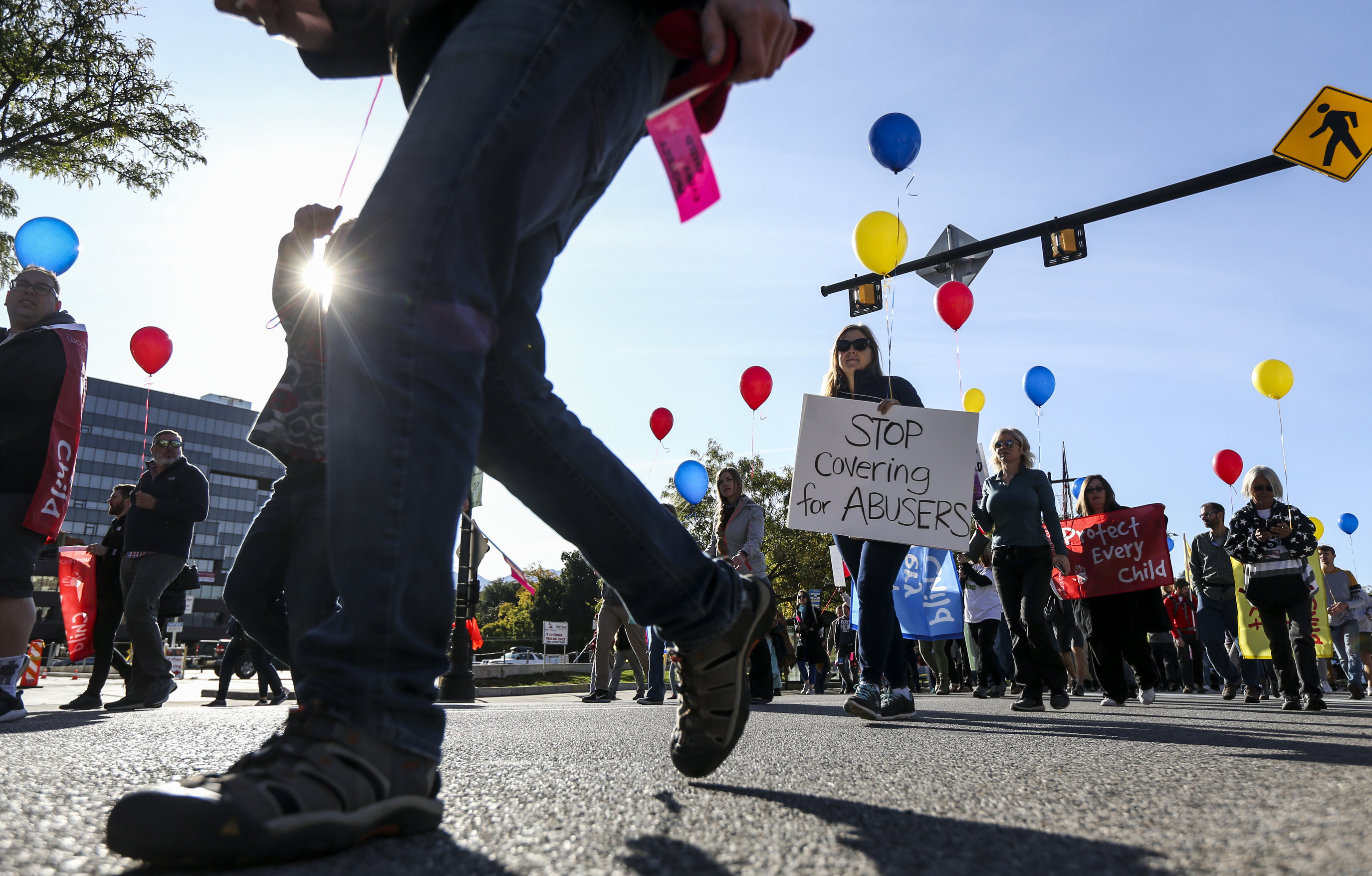 Hundreds march north along State Street from the Salt Lake City-County Building to the state Capitol during the March to End Child Abuse, organized by Protect Every Child, in Salt Lake City on Saturday, Oct. 5, 2019. More than 500 people turned out for the event.