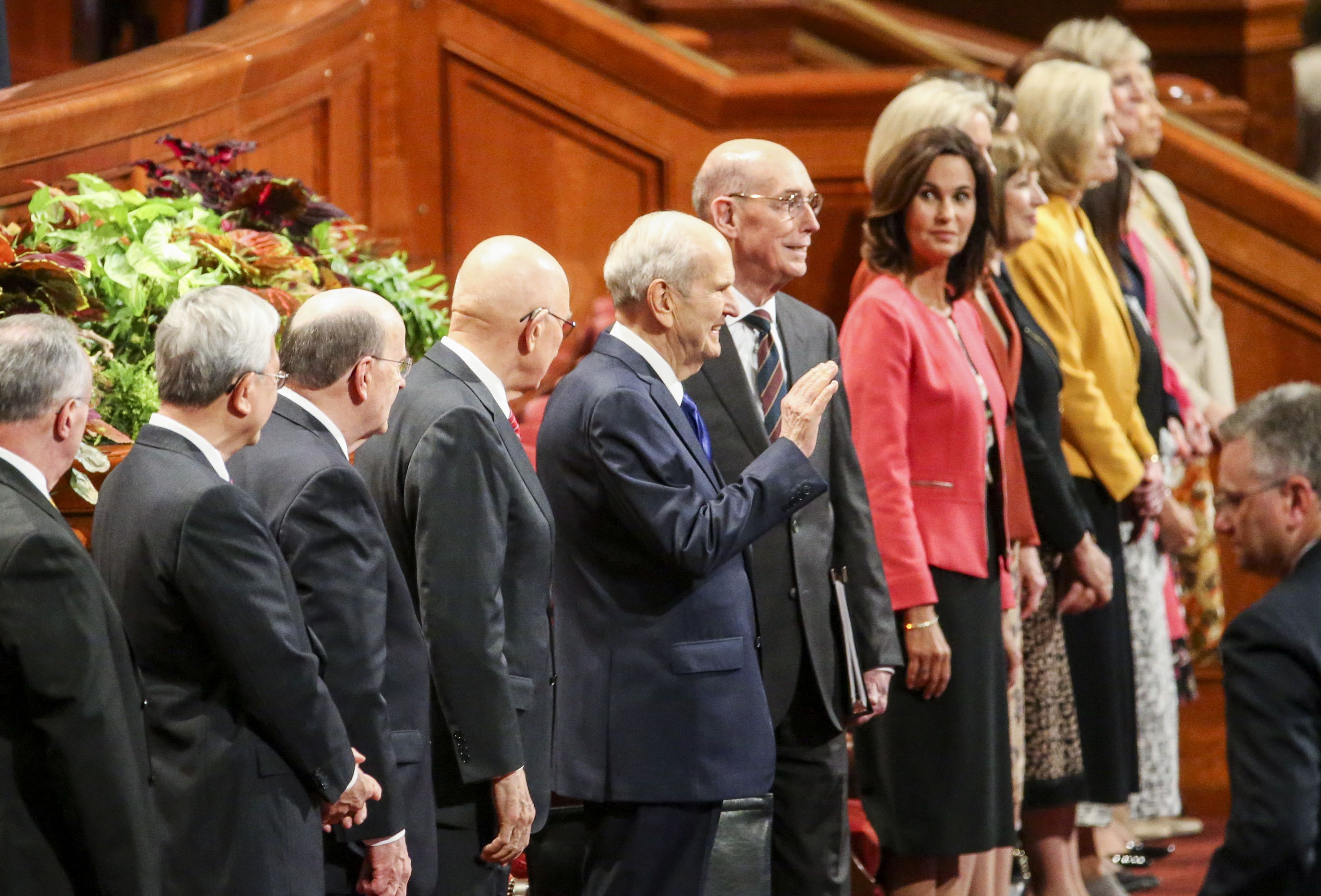 President Russell M. Nelson, center, waves to conferencegoers before the general women's session of the 189th Semiannual General Conference of The Church of Jesus Christ of Latter-day Saints in the Conference Center in Salt Lake City on Saturday, Oct. 5, 2019.