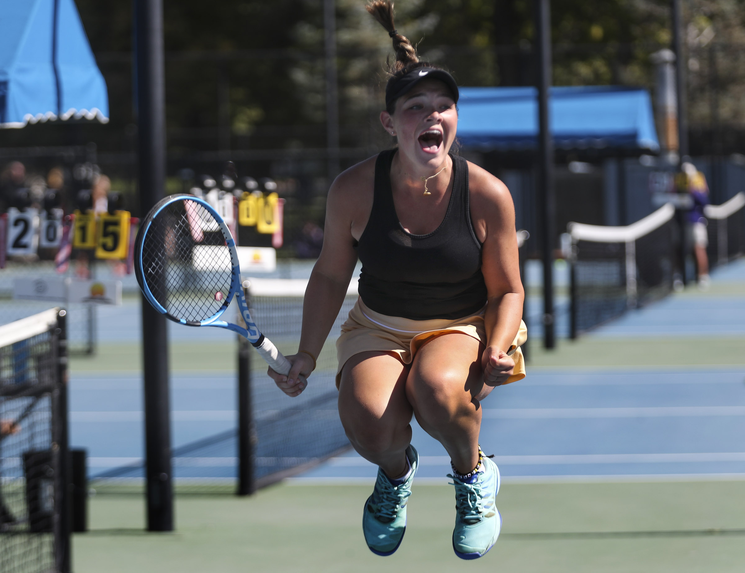 Desert Hills' Cassidy Kohler jumps into the air with excitement as she and her partner, Faith Hess, defeated Dixie for the first doubles championship during the 4A girl's tennis championships at Liberty Park in Salt Lake City on Saturday, Oct. 5, 2019.