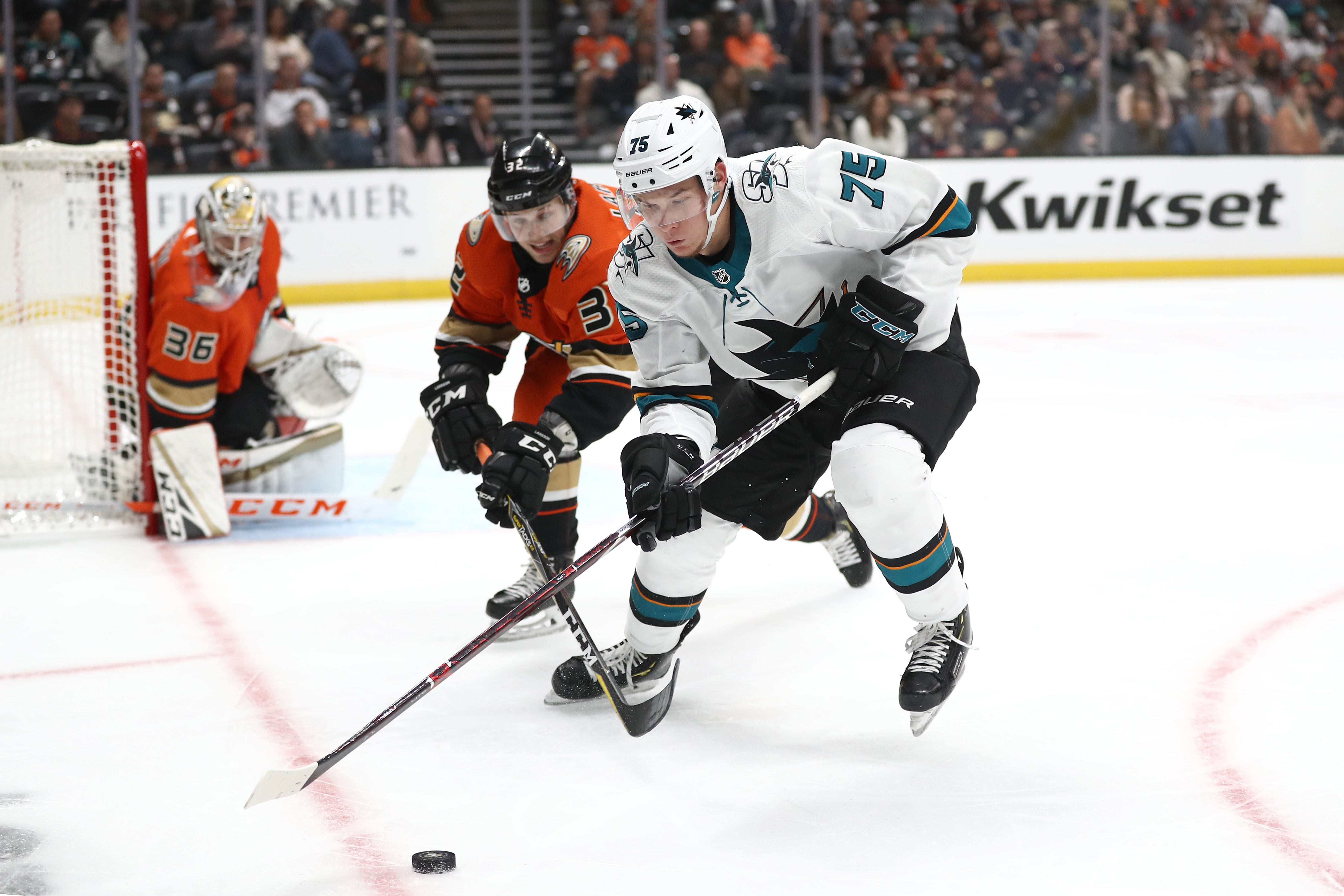 Jacob Larsson #32 of the Anaheim Ducks battles Danil Yurtaykin #75 of the San Jose Sharks for a loose puck during the second period of a game at Honda Center on October 05, 2019 in Anaheim, California.