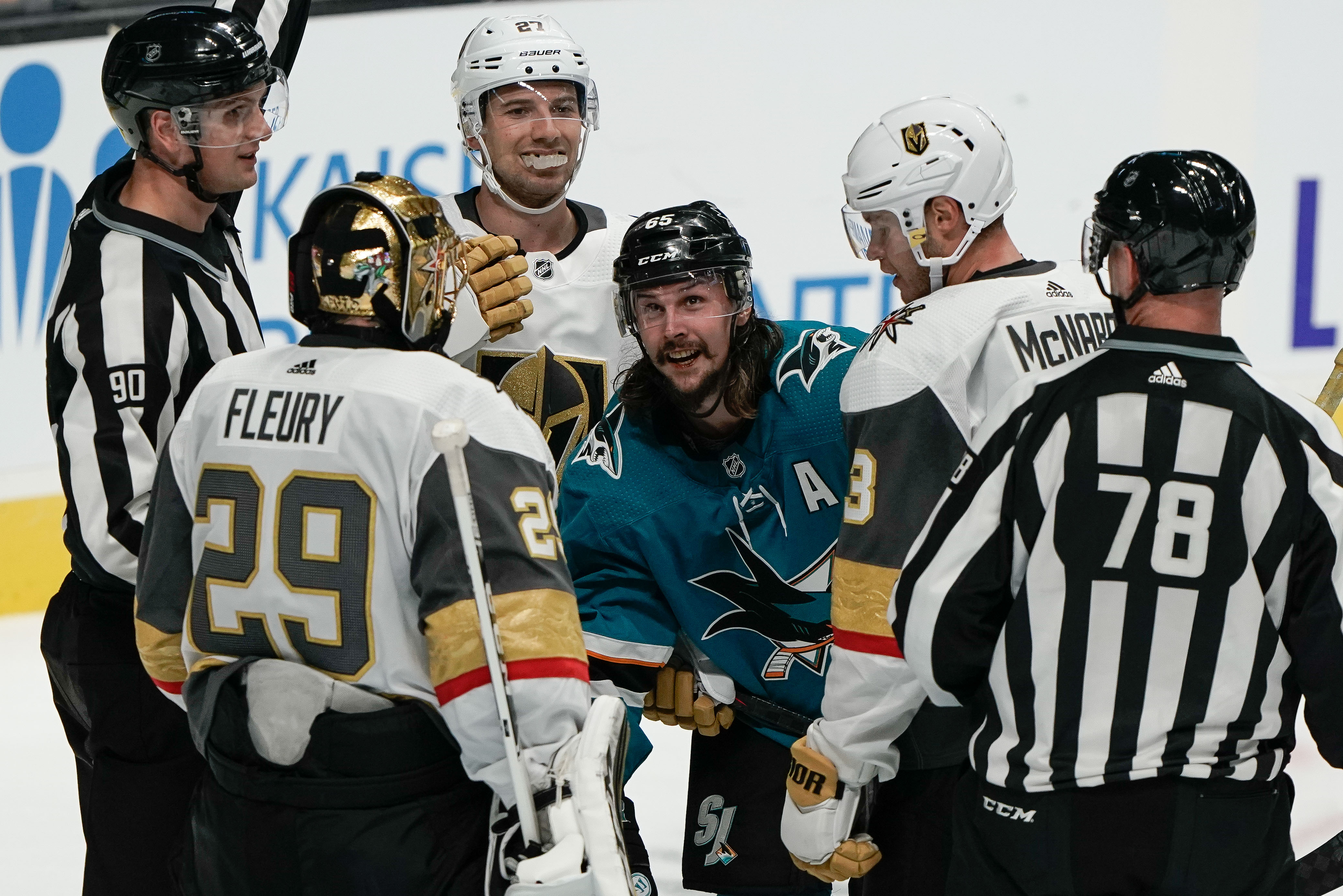 San Jose Sharks defenseman Erik Karlsson reacts after the whistle as he is surrounded by Vegas Golden Knights goaltender Marc-Andre Fleury, defenseman Shea Theodore and defenseman Brayden McNabb during the third period at SAP Center at San Jose.