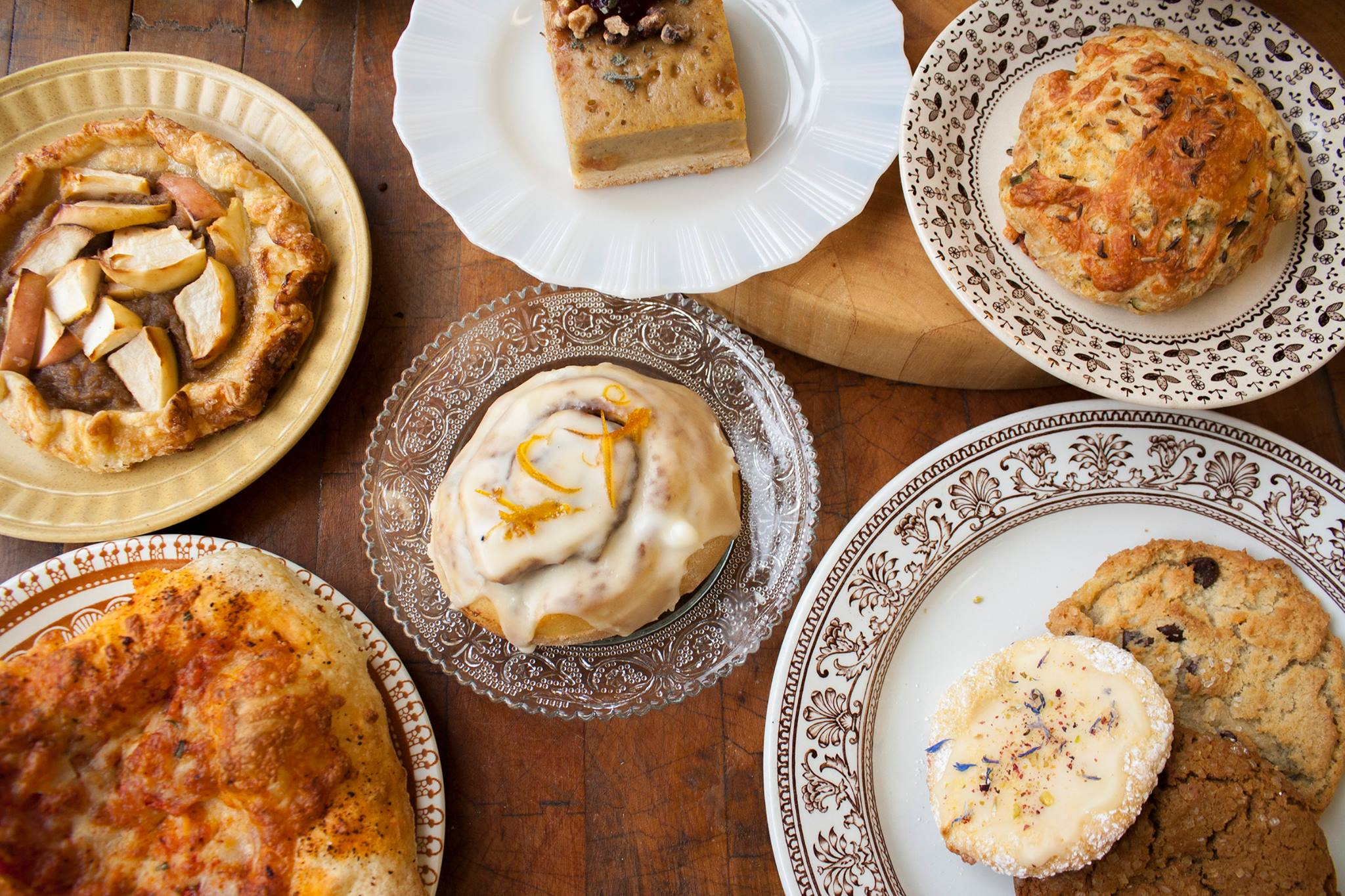 A selection of fall pastries on patterned plates.