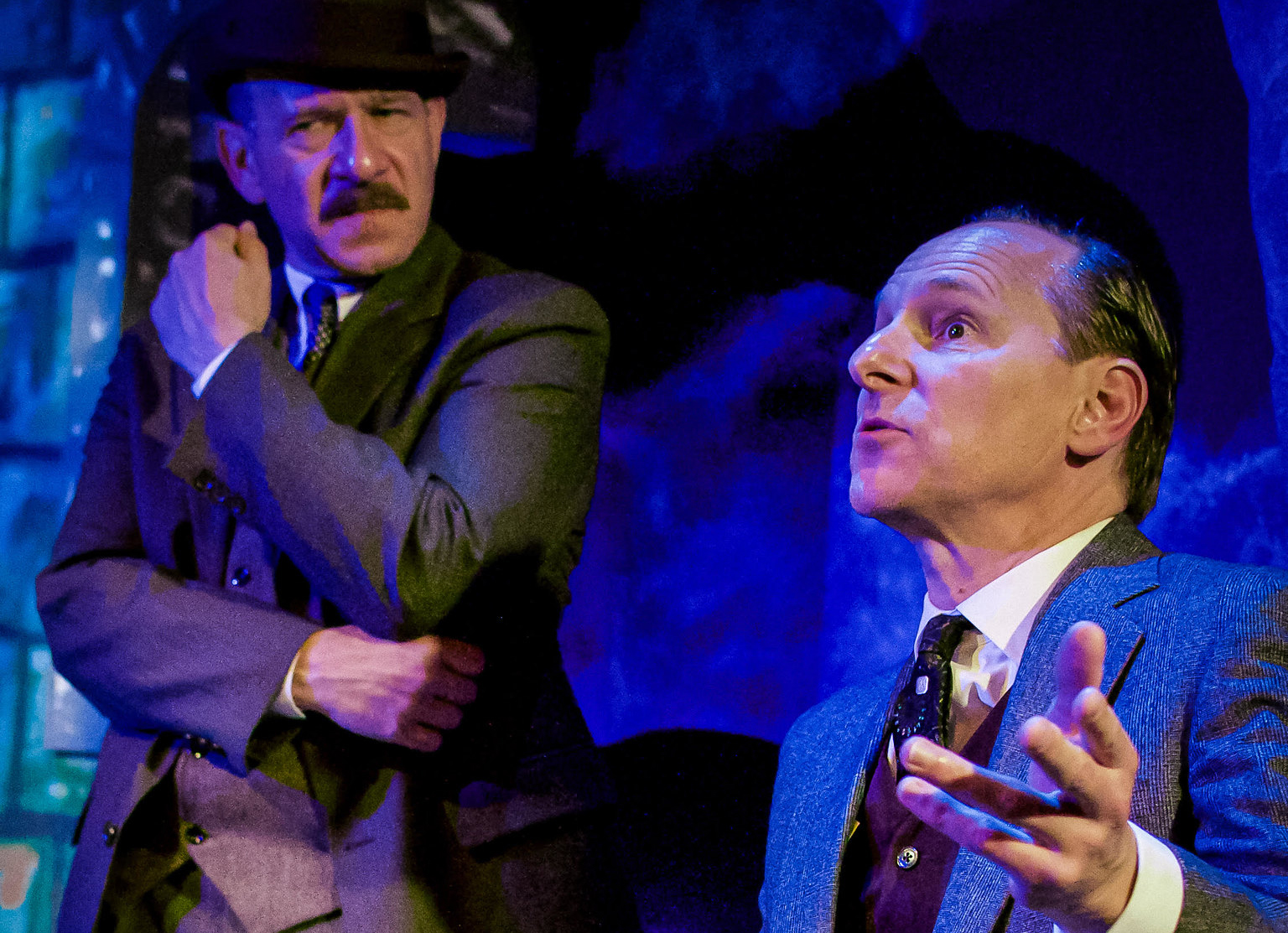 "Adam Bitterman (left) as Dr. Watson and James Sparling as Sherlock Holmes in a scene from City Lit's production of ""The Hound of the Baskervilles."""